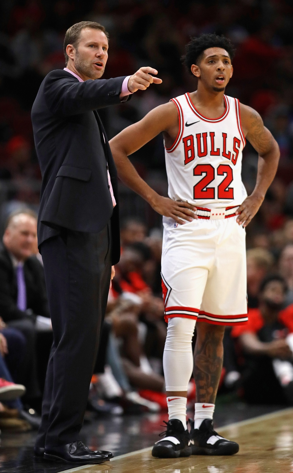 Head coach Fred Hoiberg of the Chicago Bulls gives instruction to Cameron Payne #22 against the Indiana Pacers during a preseason game at the United Center on October 10, 2018 in Chicago, Illinois.