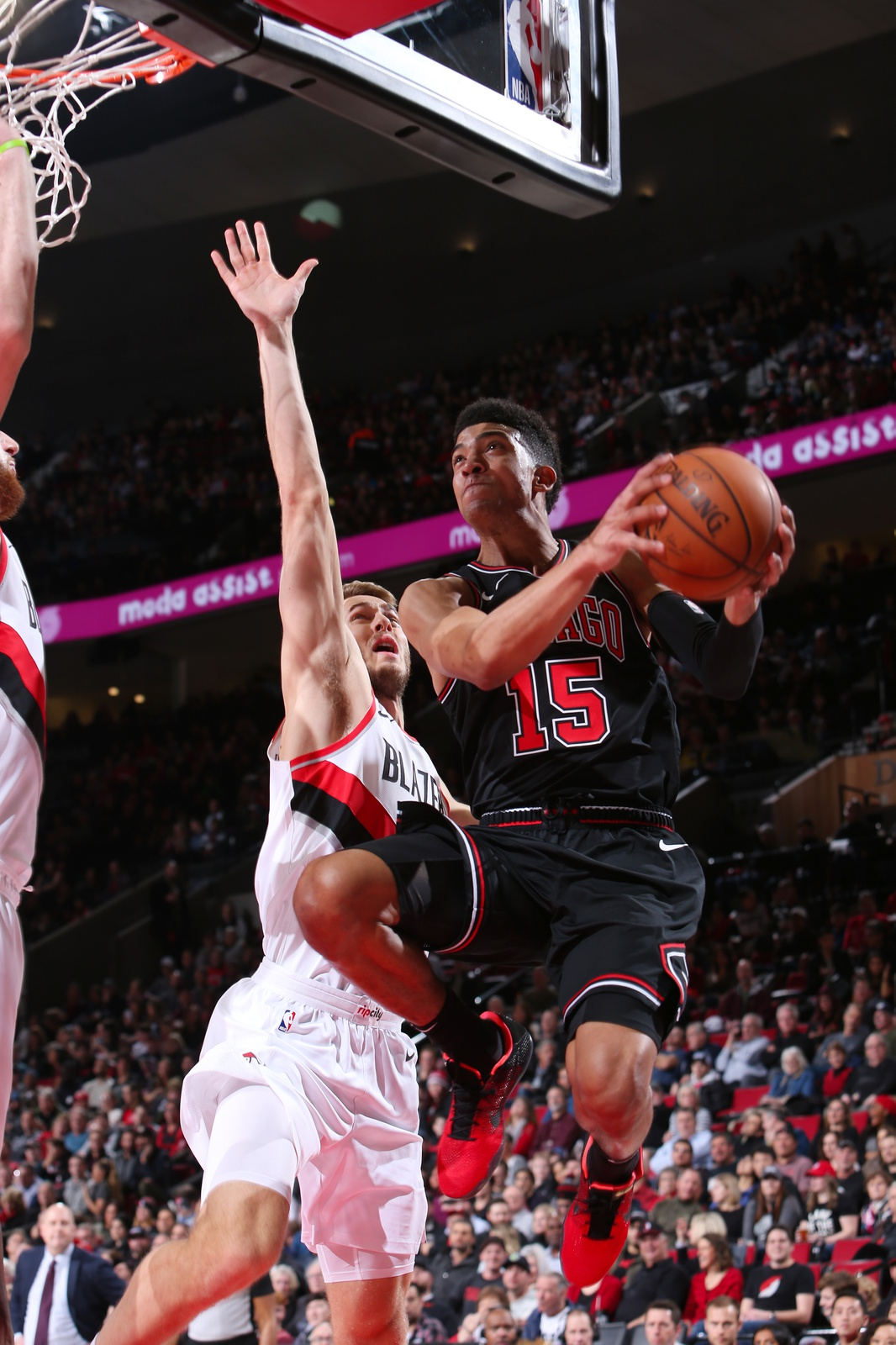 Chandler Hutchison #15 of the Chicago Bulls drives to the basket during the game against the Portland Trail Blazers on January 9, 2019 at the Moda Center Arena in Portland, Oregon.