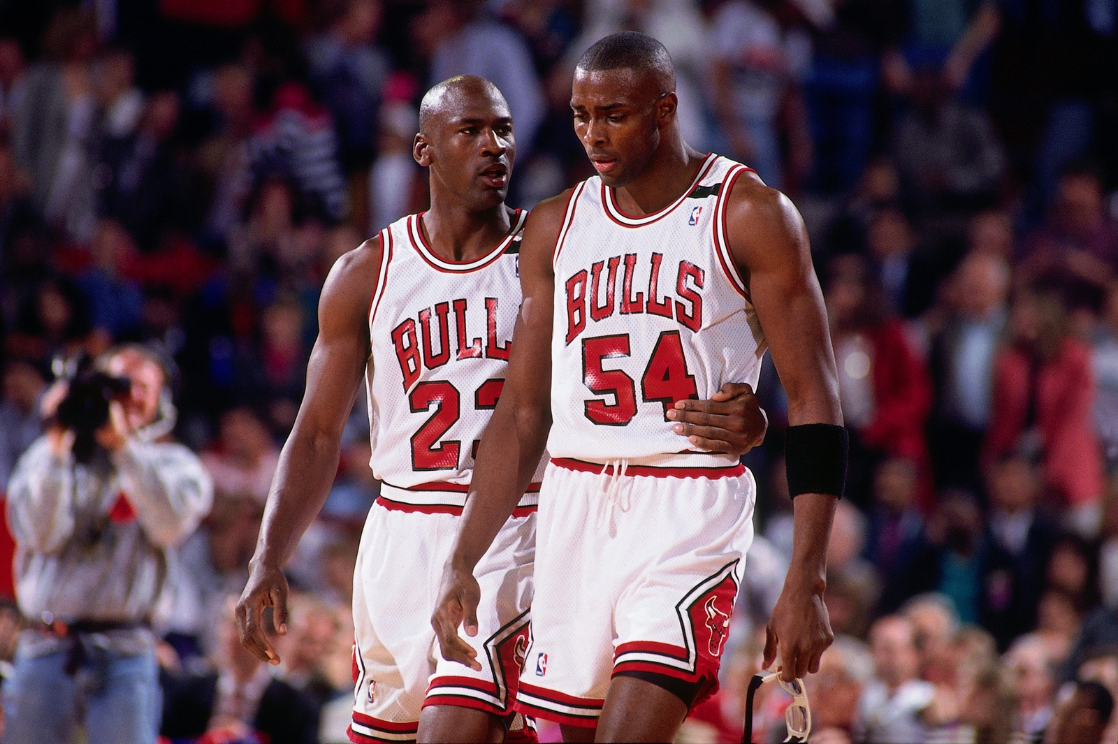 Michael Jordan #23 comforts teammate Horace Grant #54 of the Chicago Bulls during Game One of the Eastern Conference Finals against the Cleveland Cavaliers played on May 19, 1992 at Chicago Stadium in Chicago, Illinois.