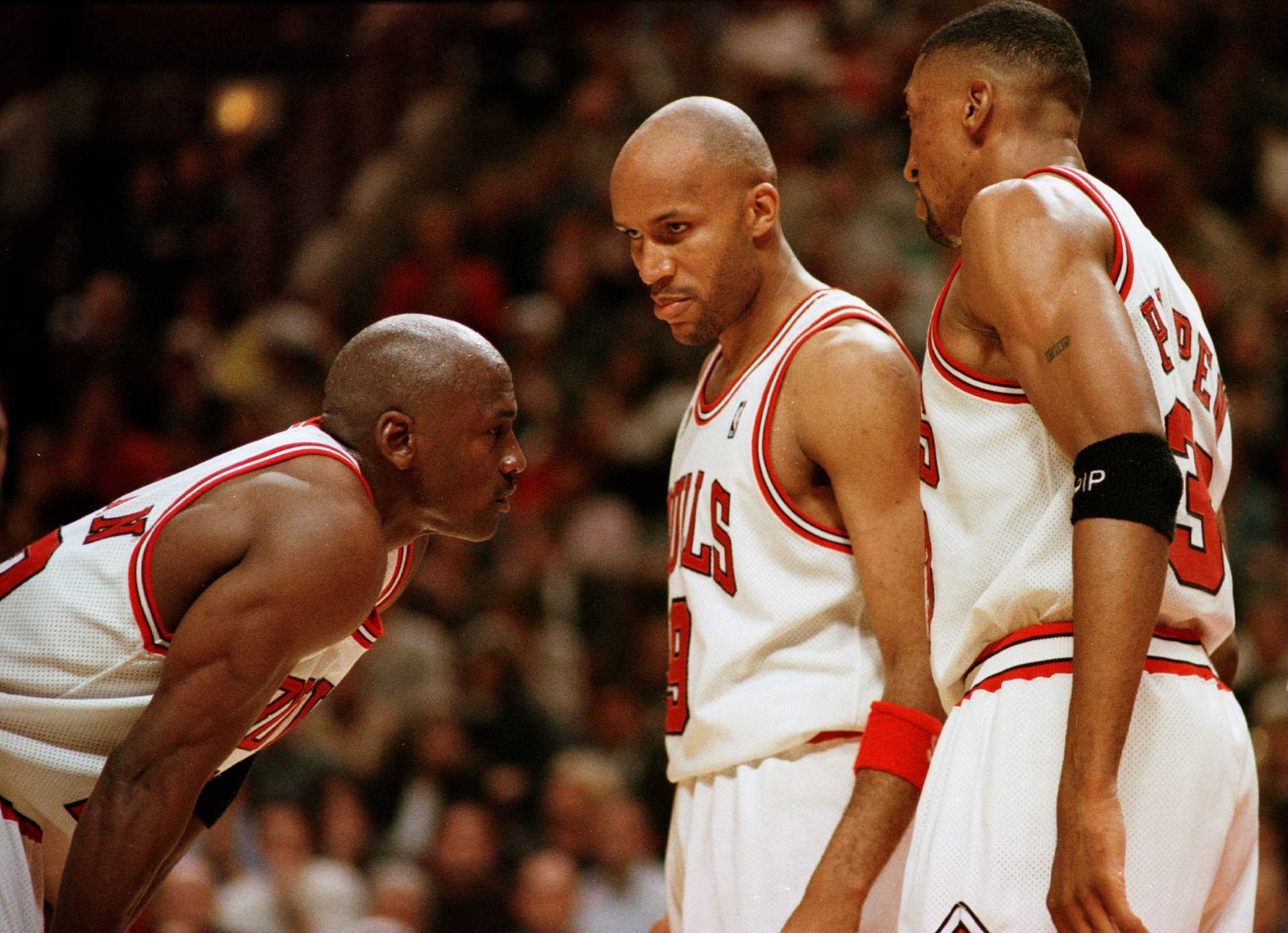 7 Jun 1996: Michael Jordan of the Chicago Bull, left, discusses strategy with teammates Ron Harper, center, and Scottie Pippen during a time-out on the court during the fourth quarter of game two in the NBA Finals at the United Center in Chicago,Illinois