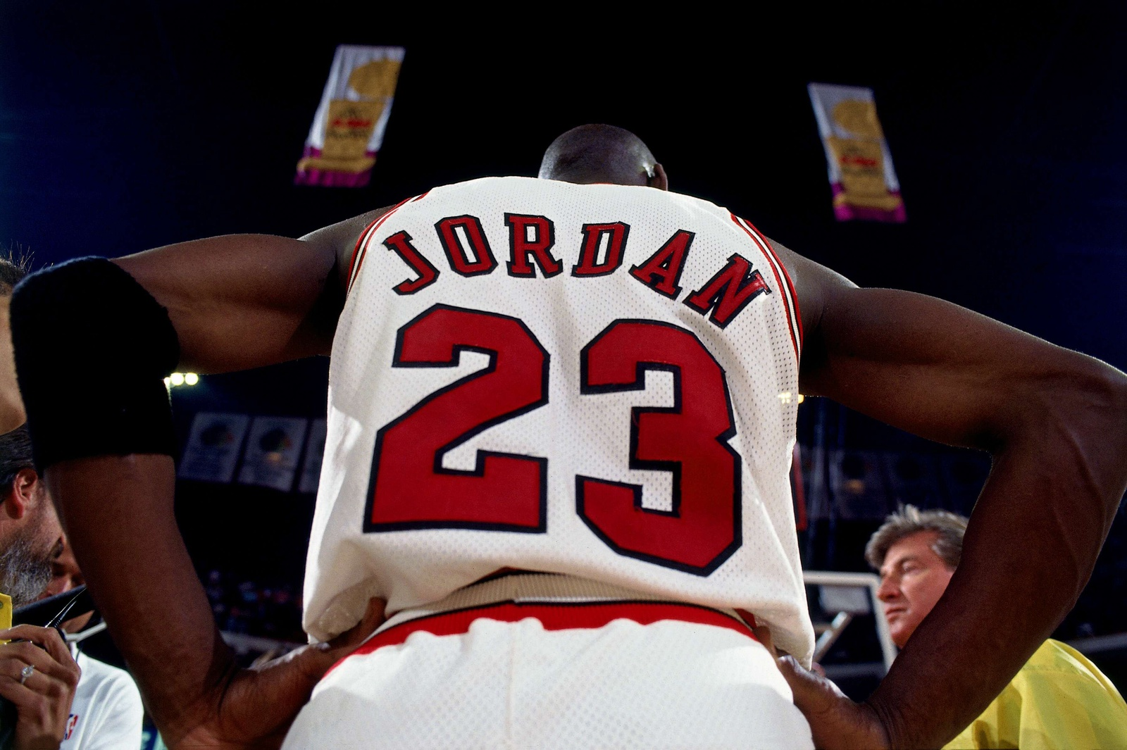 Michael Jordan #23 of the Chicago Bulls stands in the huddle against the Phoenix Suns in Game Four of the 1993 NBA Finals on June 16, 1993 at the Chicago Stadium in Chicago, Illinois. The Bulls won 111-105.