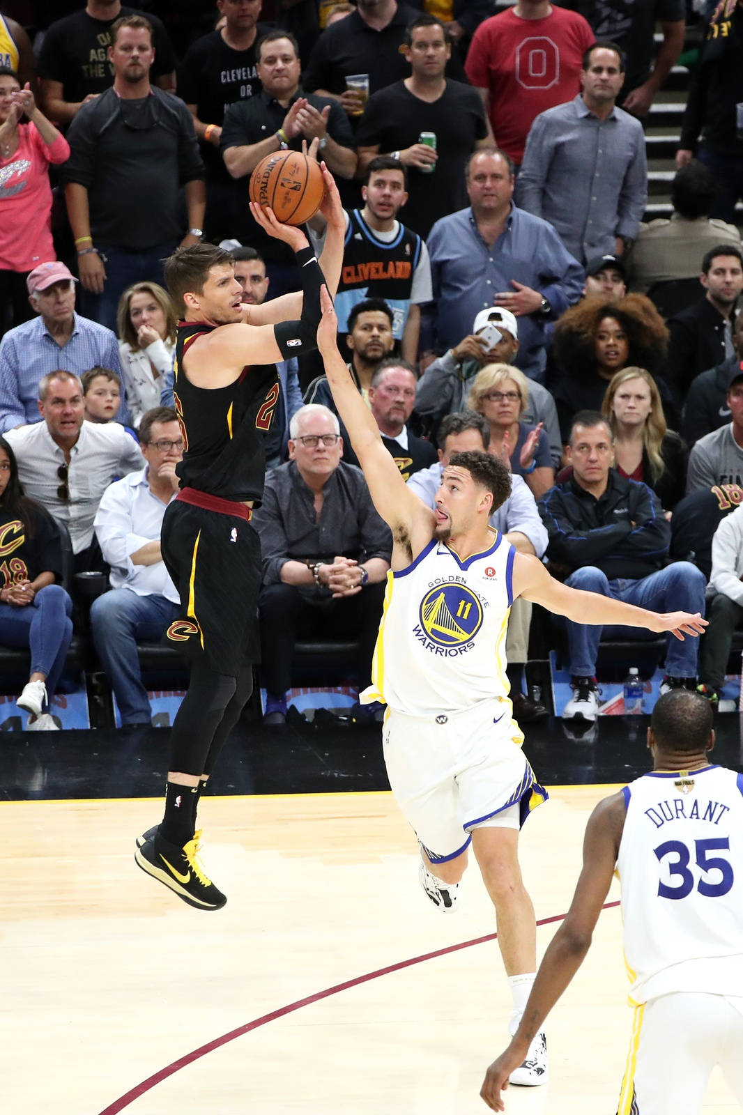 Klay Thompson #11 of the Golden State Warriors blocks Kyle Korver #26 of the Cleveland Cavaliers in Game Four of the 2018 NBA Finals on June 8, 2018 at Quicken Loans Arena in Cleveland, Ohio.
