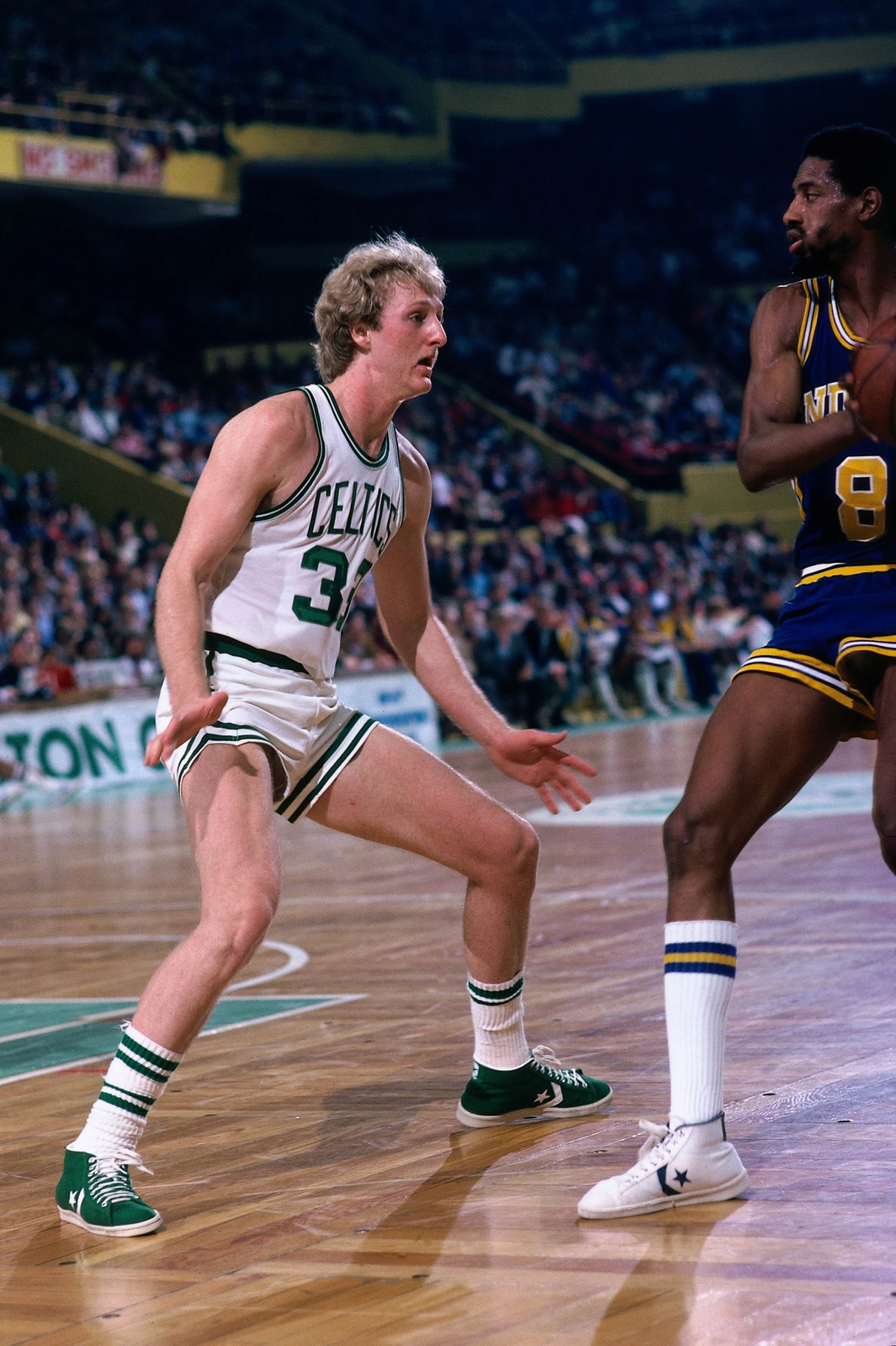 Mickey Johnson #8 of the Indiana Pacers looks to make a move against Larry Bird #33 of the Boston Celtics during a game played in 1980 at the Boston Garden in Boston, Massachusetts.