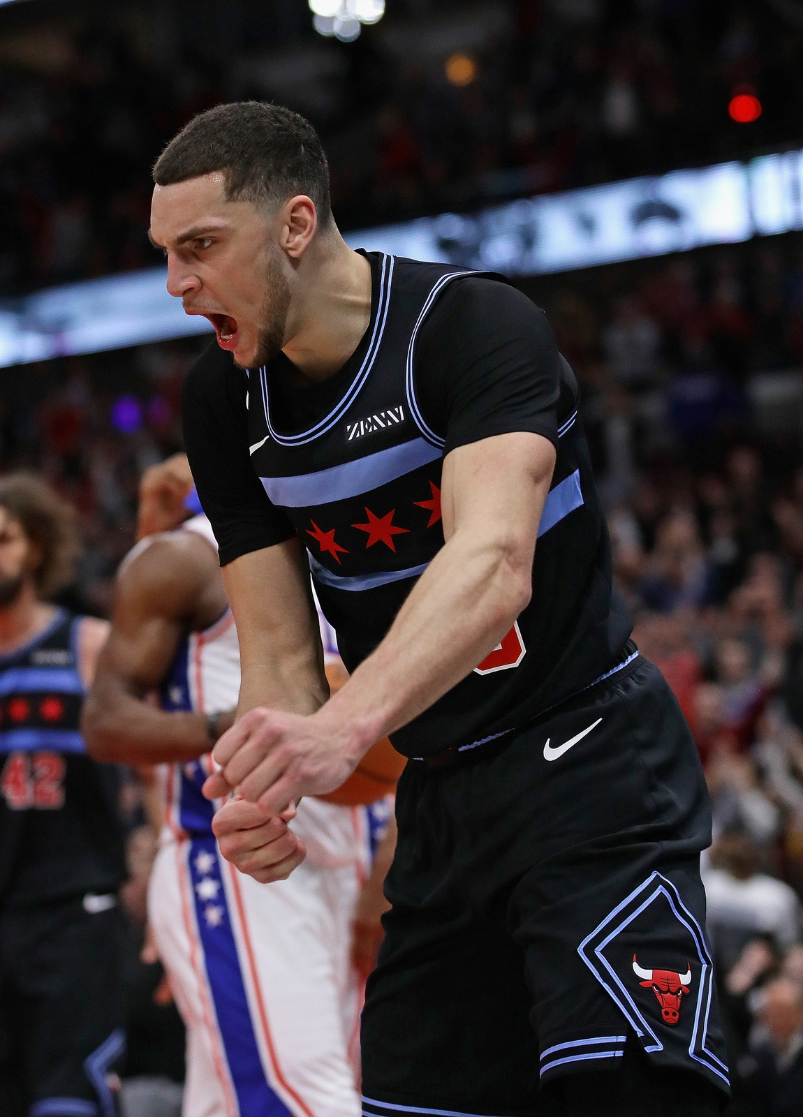 Zach LaVine #8 of the Chicago Bulls celebrates after hitting the game-winning shot against the Philadelphia 76ers at the United Center on March 06, 2019 in Chicago, Illinois. The Bulls defeated the 76ers 108-107.