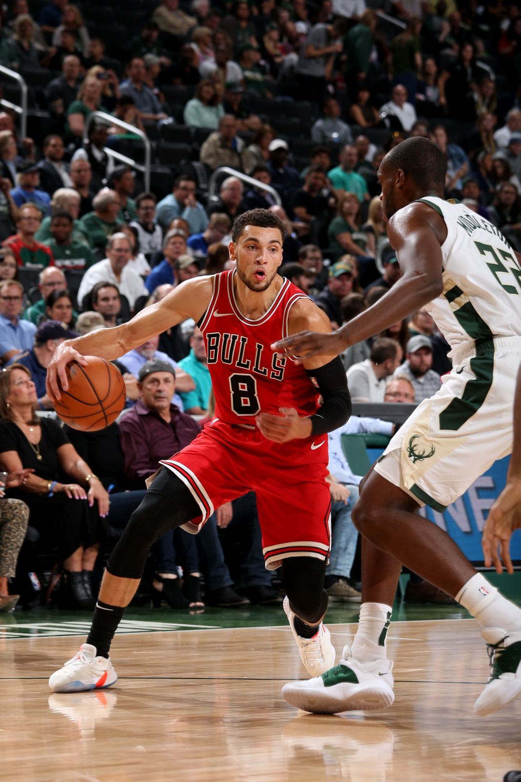 Zach LaVine #8 of the Chicago Bulls handles the ball against the Milwaukee Bucks during a pre-season game on October 3, 2018 at Fiserv Forum, in Milwaukee, Wisconsin.