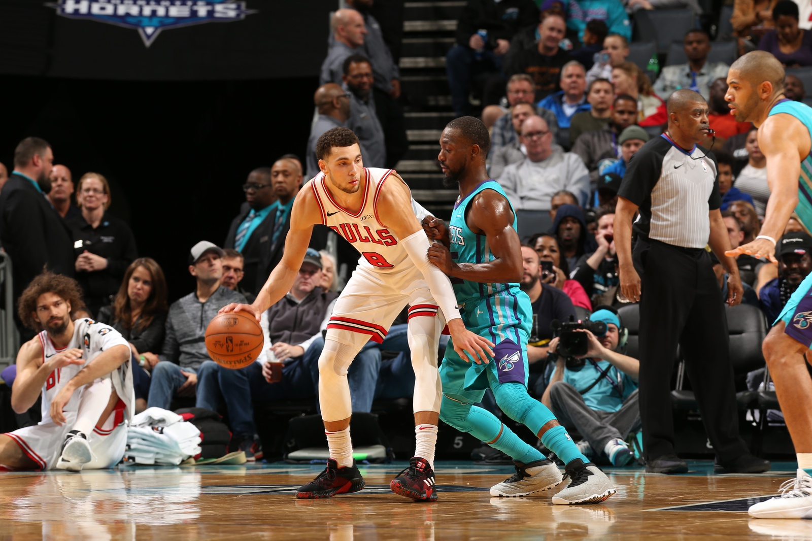Zach LaVine handles the ball against Kemba Walker of the Charlotte Hornets