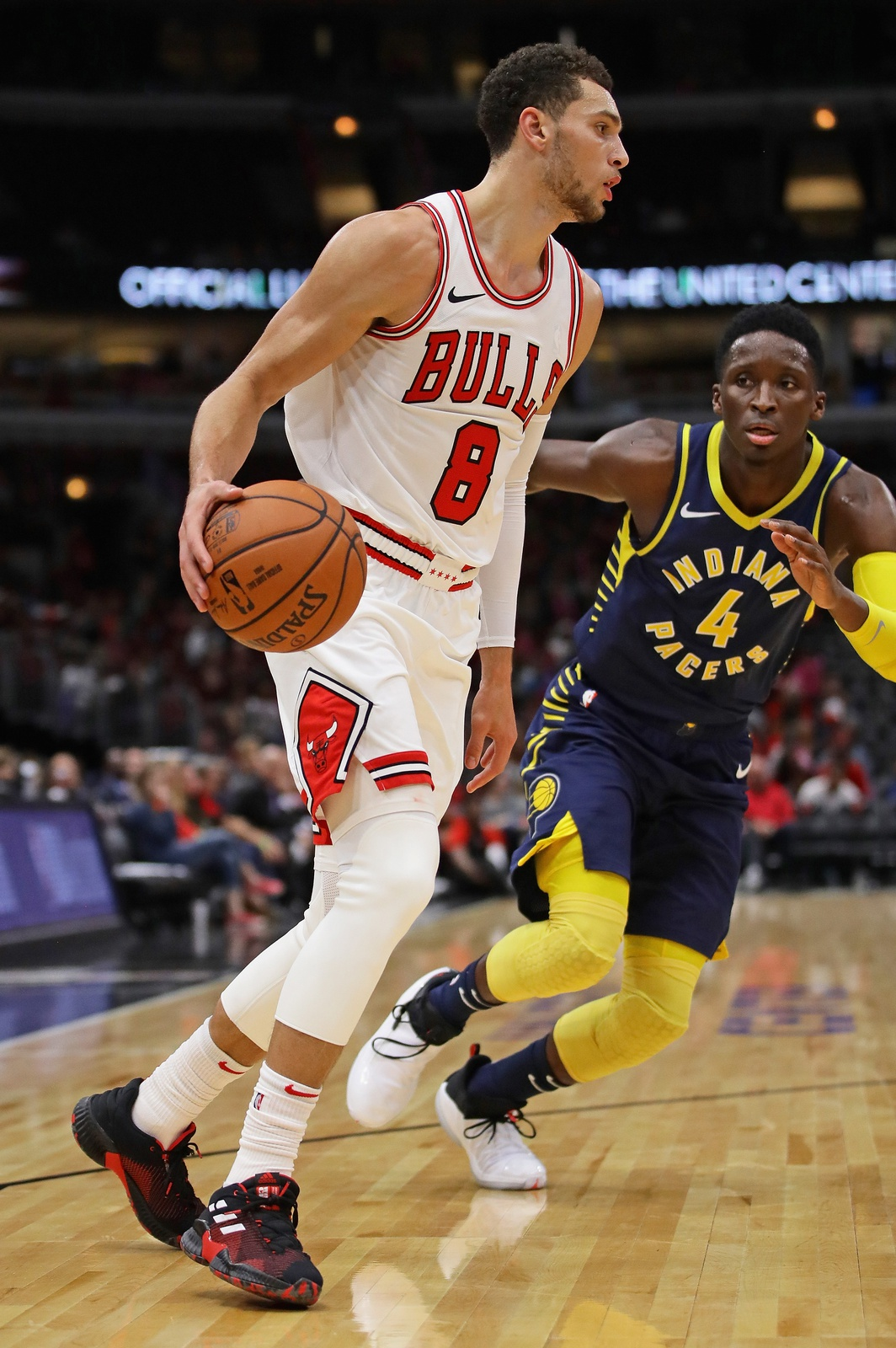 Zach LaVine #8 of the Chicago Bulls moves against Victor Oladipo #4 of the Indiana Pacers during a preseason game at the United Center on October 10, 2018 in Chicago, Illinois.
