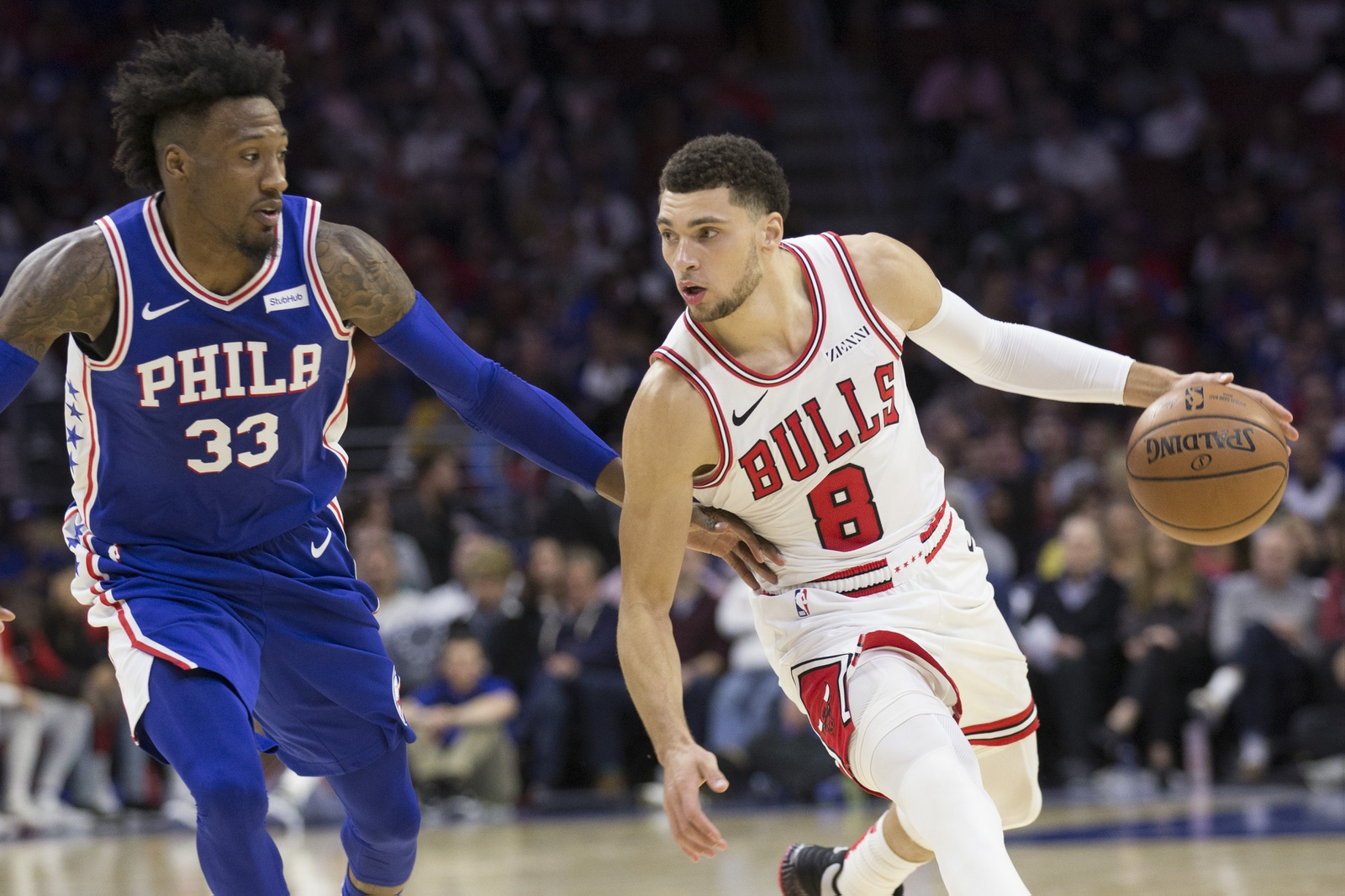 Zach LaVine #8 of the Chicago Bulls drives to the basket against Robert Covington #33 of the Philadelphia 76ers in the third quarter at Wells Fargo Center on October 18, 2018 in Philadelphia, Pennsylvania. The 76ers defeated the Bulls 127-108.