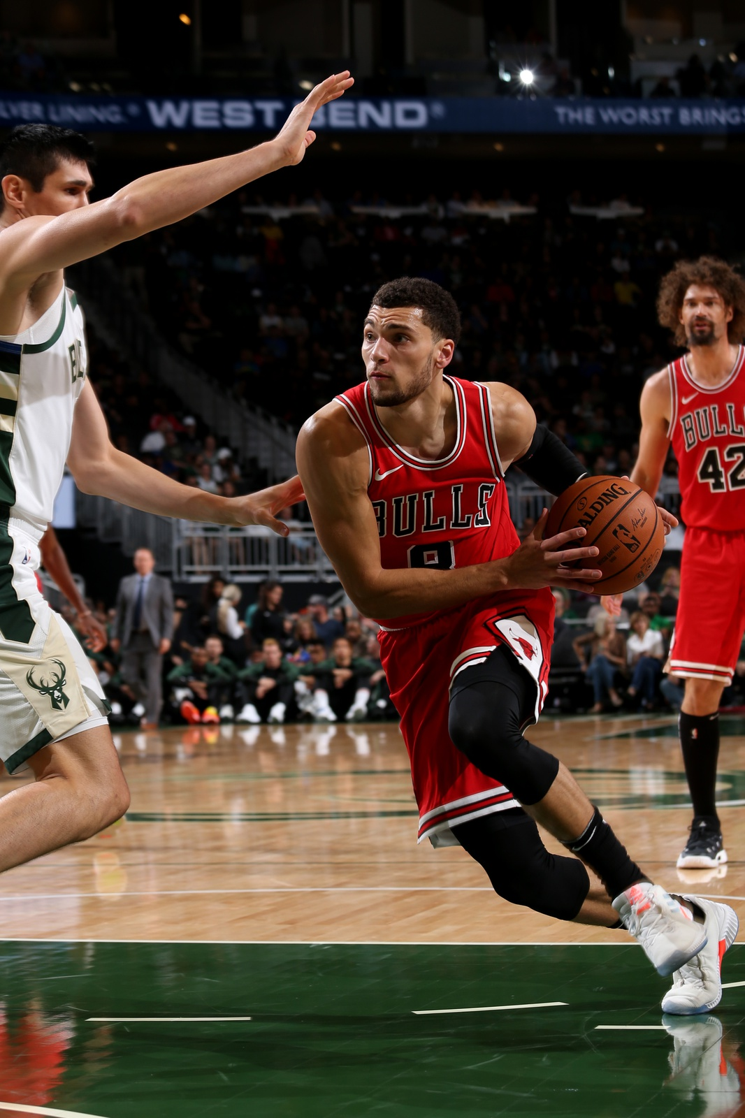 ach LaVine #8 of the Chicago Bulls drives to the basket against the Milwaukee Bucks during a pre-season game on October 3, 2018 at Fiserv Forum, in Milwaukee, Wisconsin