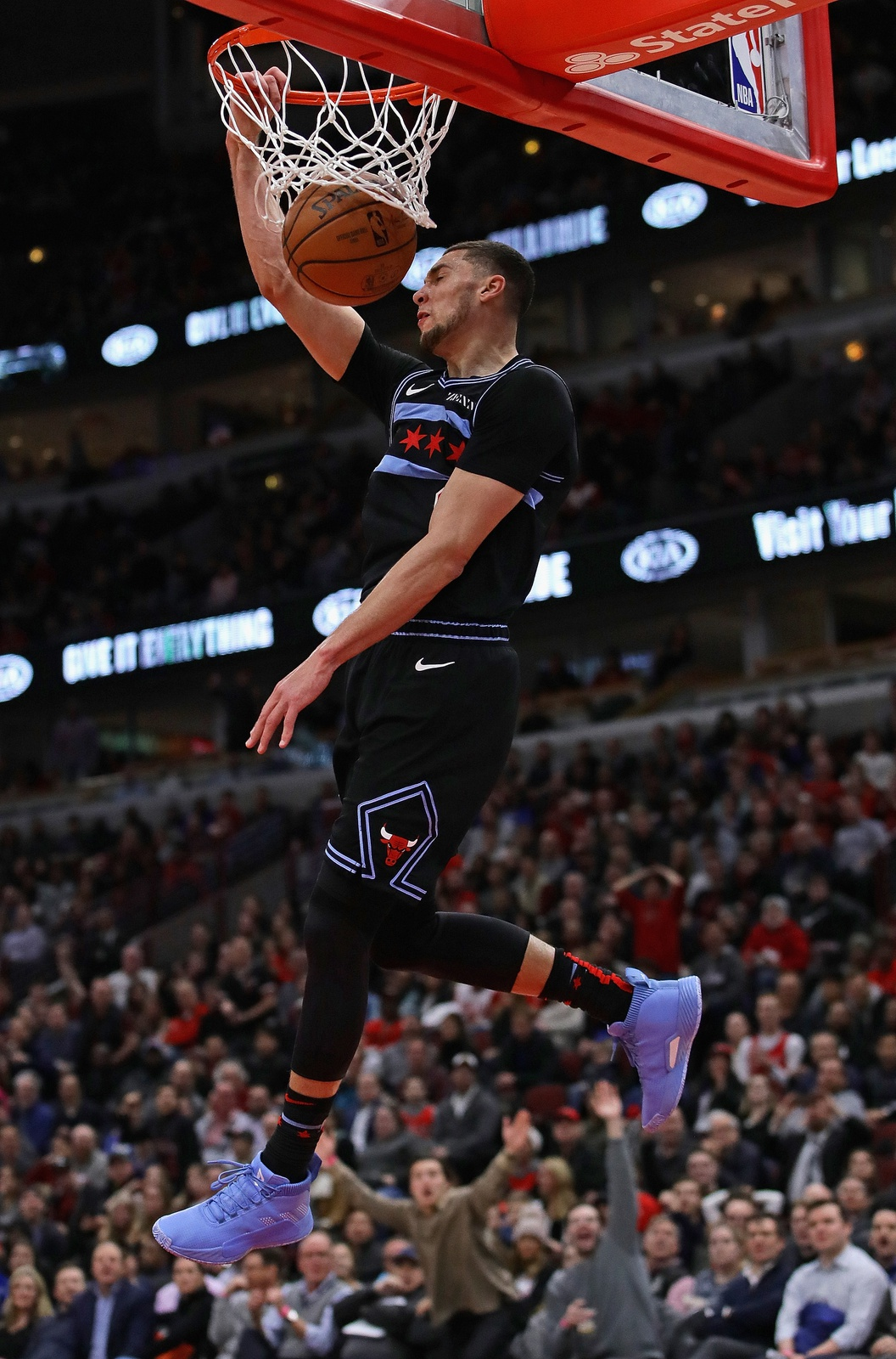 Zach LaVine #8 of the Chicago Bulls dunks against the Philadelphia 76ers on his way to a game-high 39 points at the United Center on March 06, 2019 in Chicago, Illinois. The Bulls defeated the 76ers 108-107.
