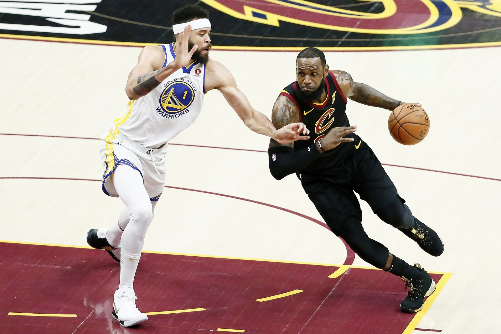 LeBron James #23 of the Cleveland Cavaliers handles the ball against JaVale McGee #1 of the Golden State Warriors in Game Four of the 2018 NBA Finals won 108-85 by the Golden State Warriors over the Cleveland Cavaliers at the Quicken Loans Arena on June 6, 2018 in Cleveland, Ohio.