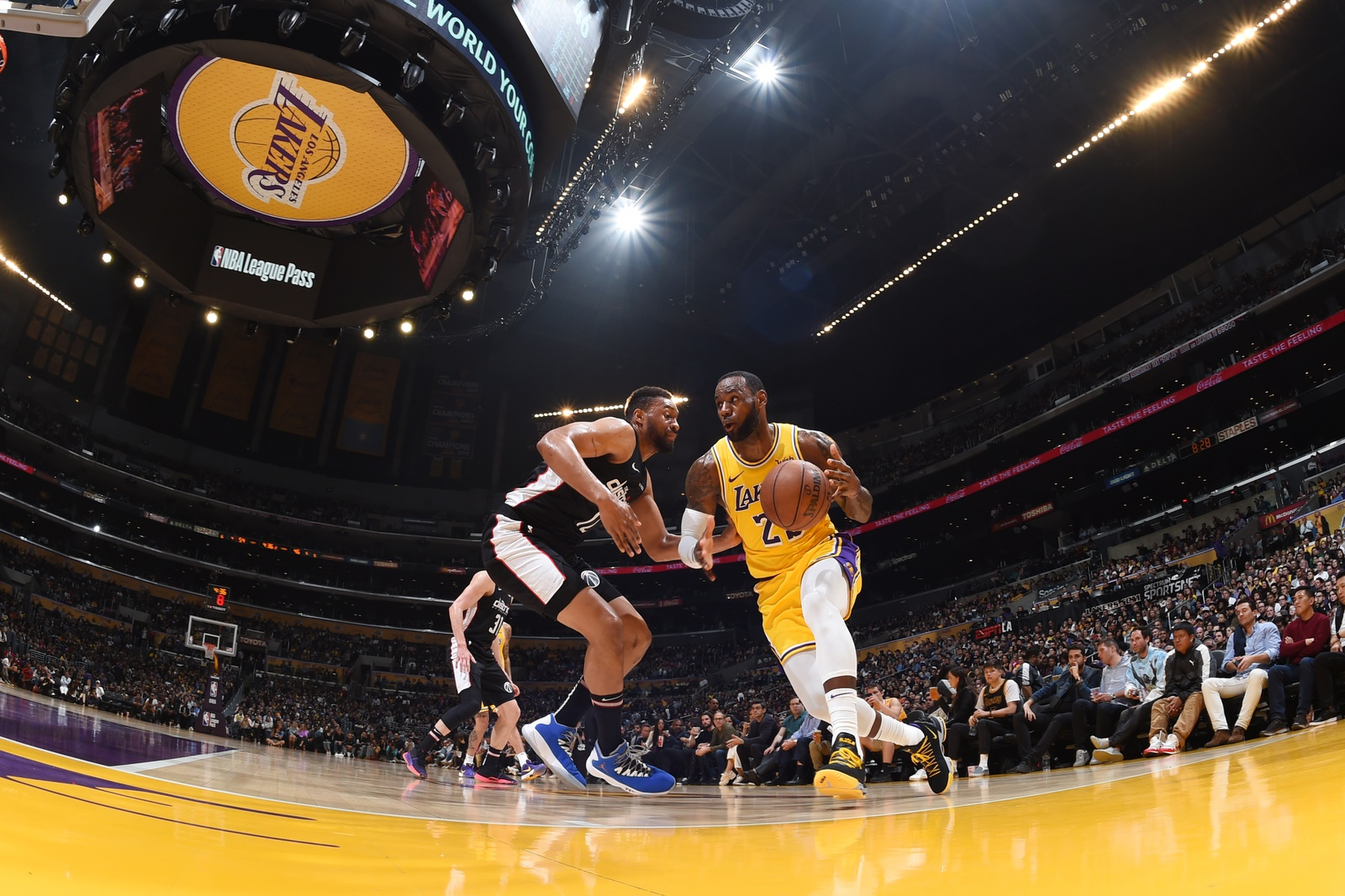 LeBron James #23 of the Los Angeles Lakers handles the ball against the Washington Wizards on March 26, 2019 at STAPLES Center in Los Angeles, California.