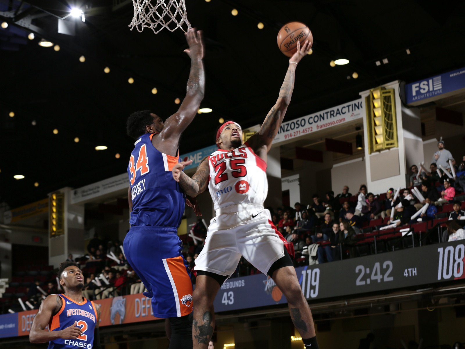 Walter Lemon Jr #25 of the Windy City Bulls drives against Jameel Warney #34 of the Westchester Knicks at the Westchester County Center on March 7, 2019 in Westchester, New York.