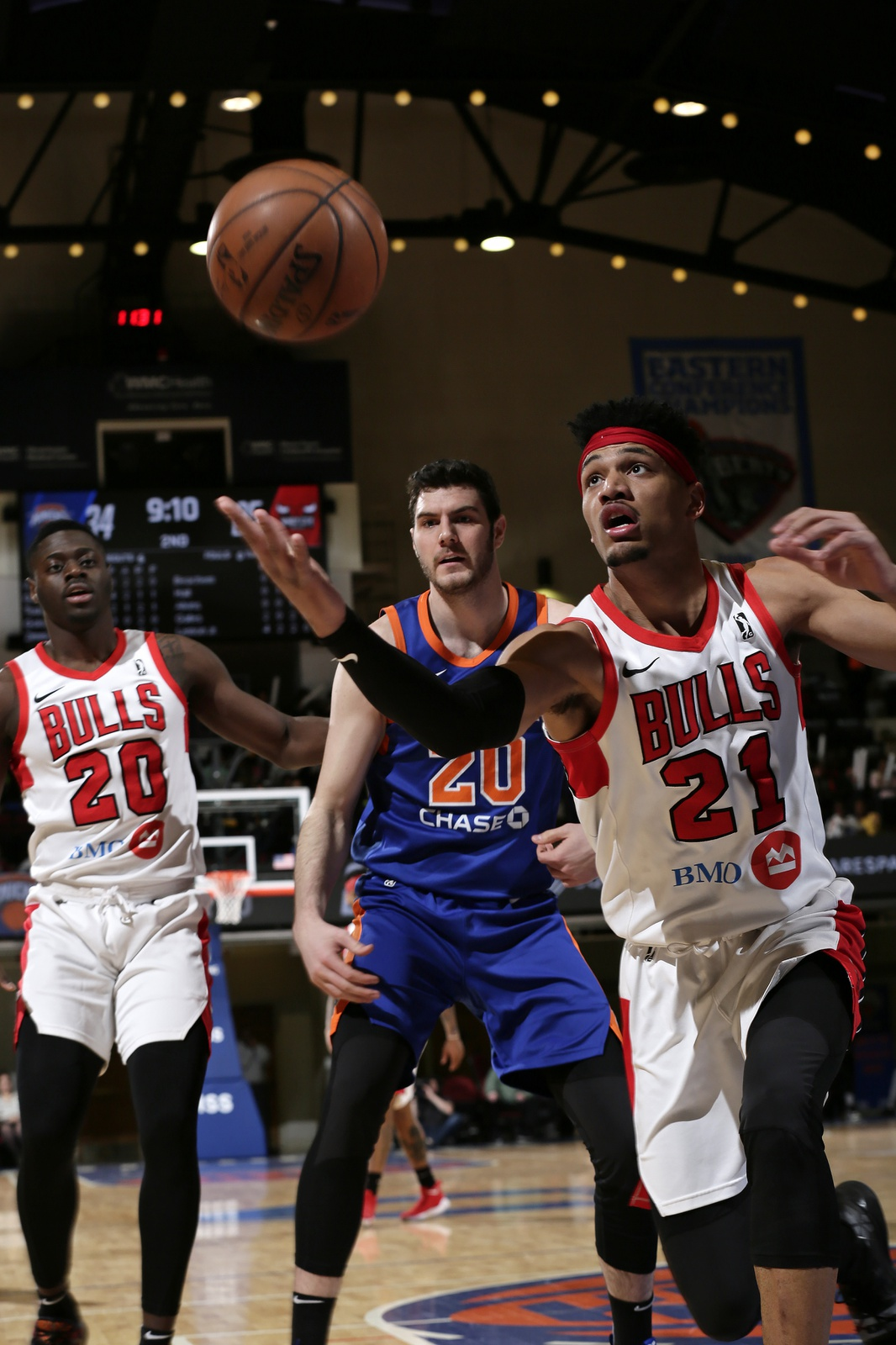 Kaiser Gates #21 of the Windy City Bulls fights for a loose ball with the Westchester Knicks at the Westchester County Center on March 7, 2019 in Westchester, New York.