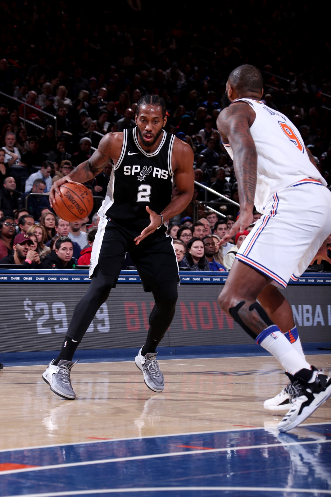 Kawhi Leonard #2 of the San Antonio Spurs handles the ball during the game against the New York Knicks on January 2, 2018 at Madison Square Garden in New York, New York.
