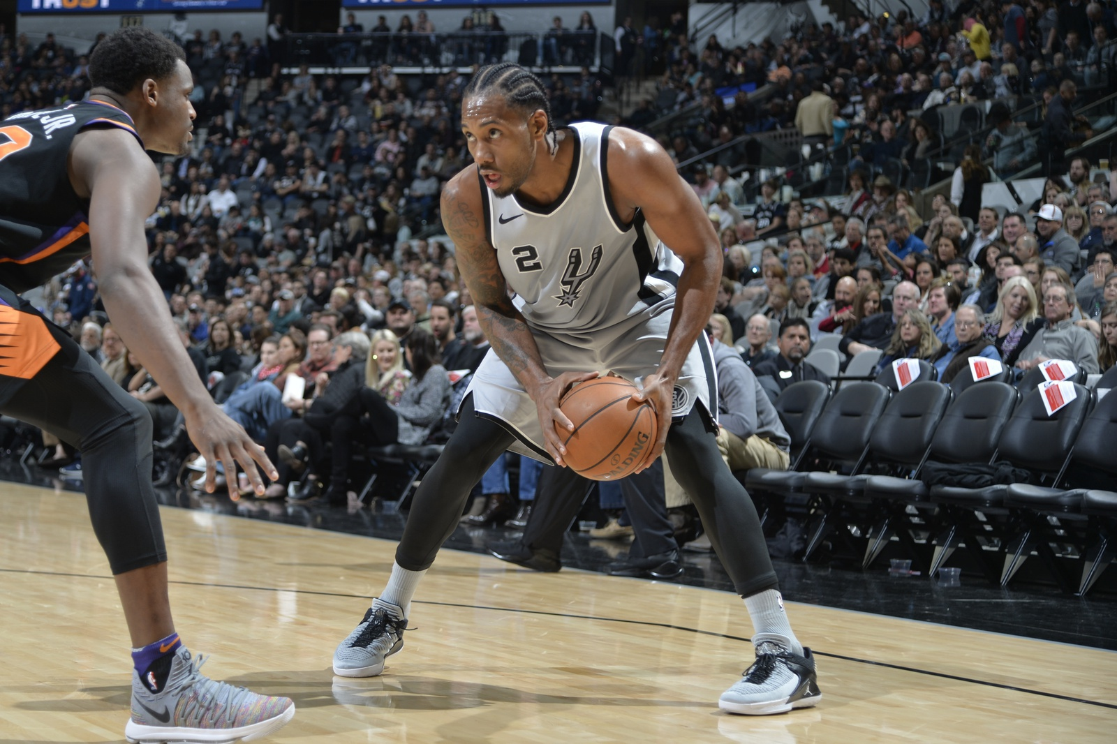 Kawhi Leonard #2 of the San Antonio Spurs handles the ball against the Denver Nuggets on January 13, 2018 at the AT&T Center in San Antonio, Texas.