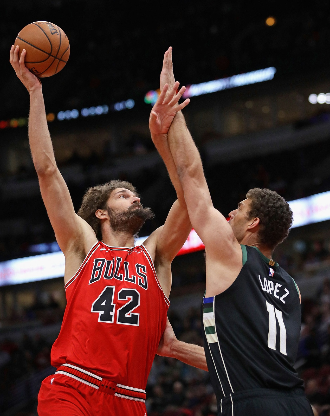 Robin Lopez (42) of the Chicago Bulls shoots over twin brother Brook Lopez (11) of the Milwaukee Bucks at the United Center on February 25, 2019 in Chicago, Illinois.