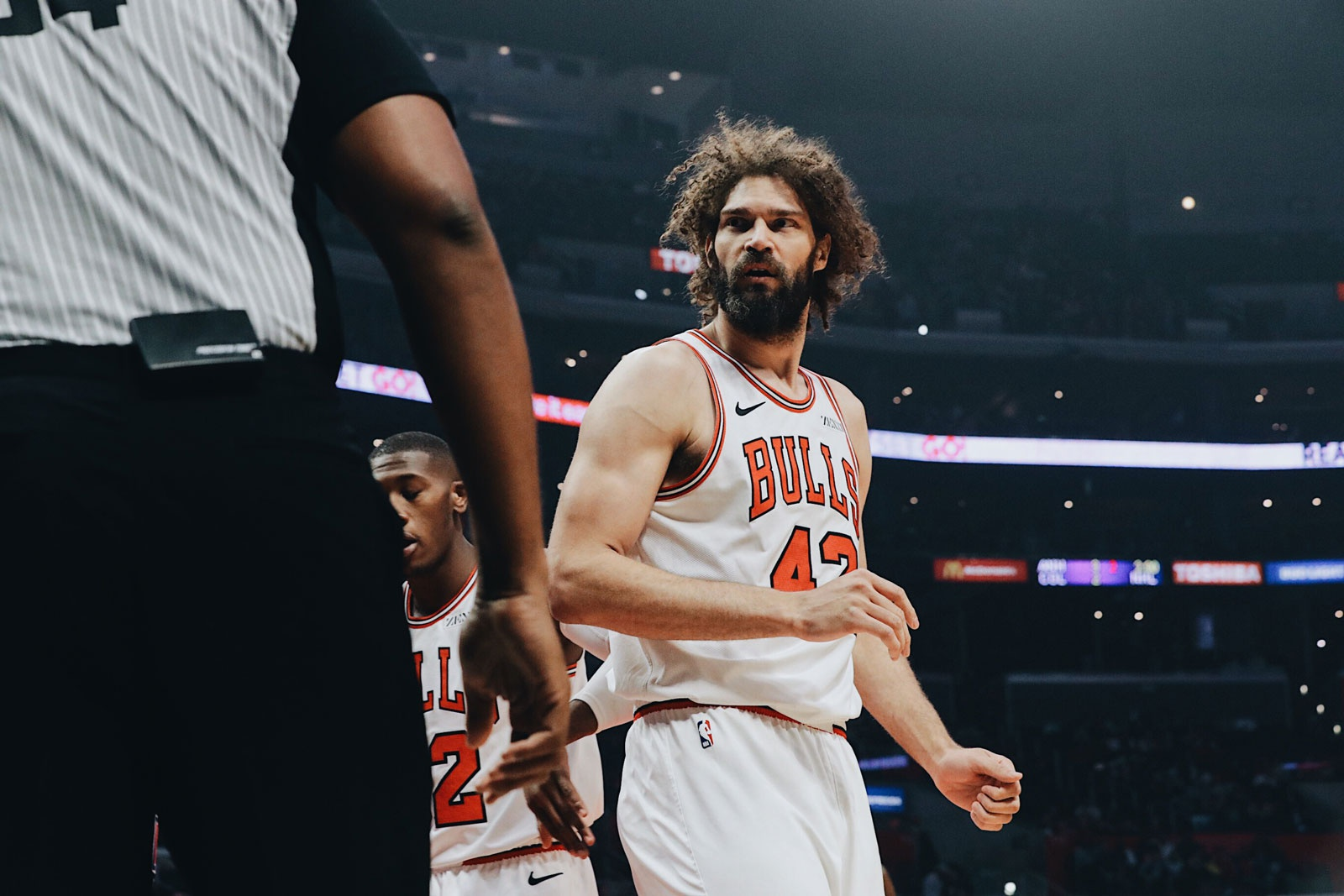 Robin Lopez talks to a referee during a game.