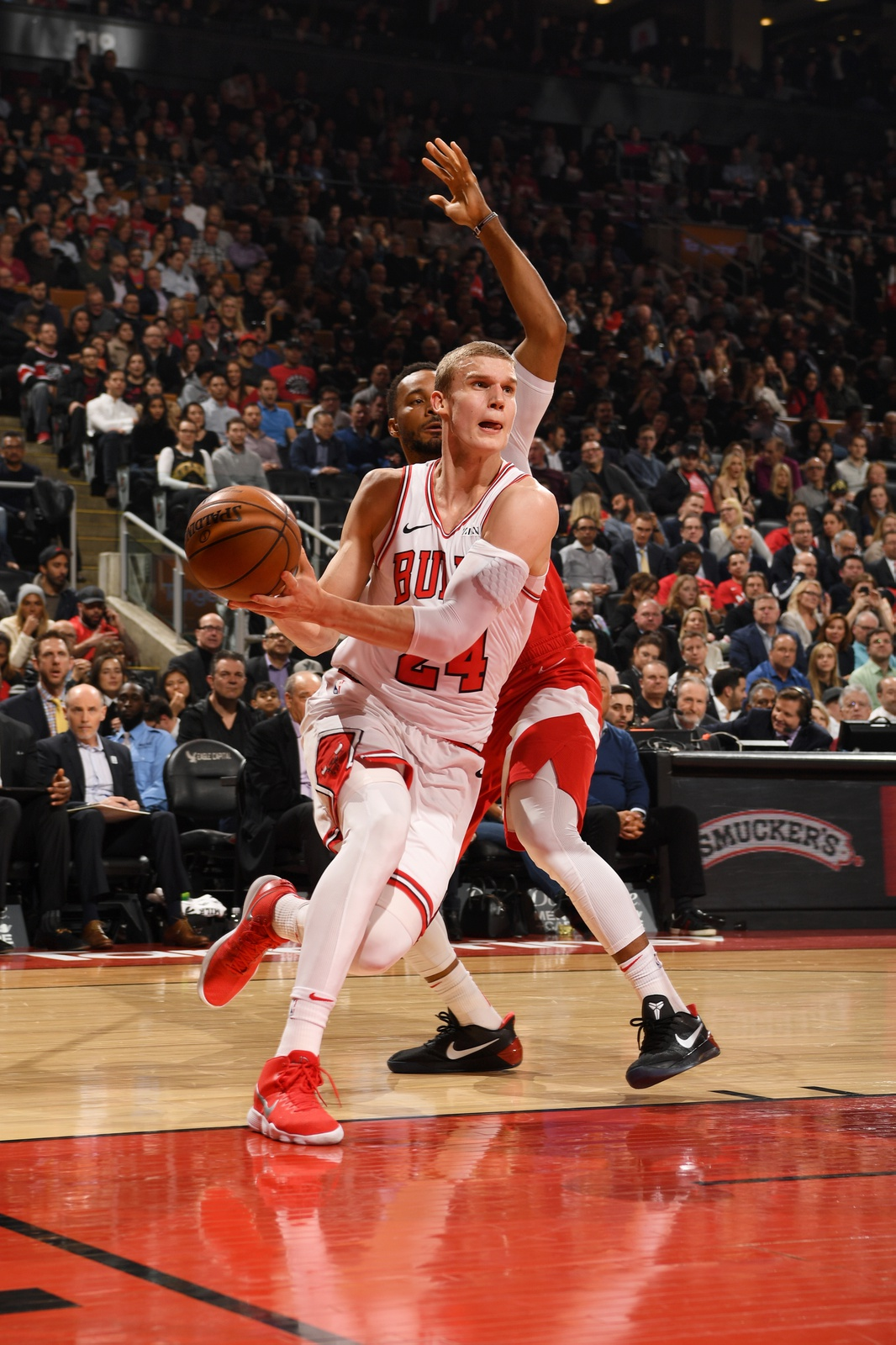 Lauri Markkanen #24 of the Chicago Bulls drives to the basket against the Toronto Raptors on March 26, 2019 at the Scotiabank Arena in Toronto, Ontario, Canada.