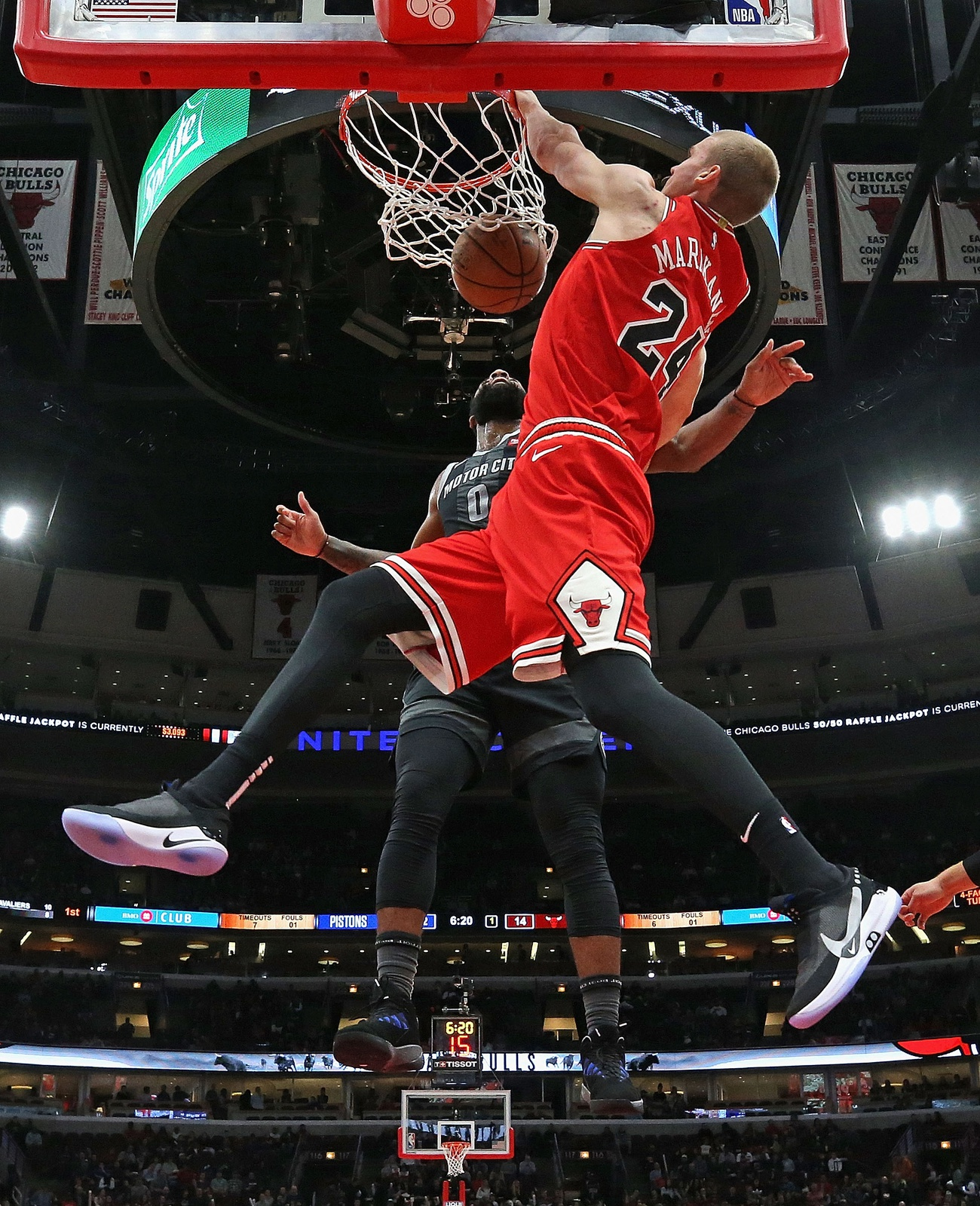 Lauri Markkanen #24 of the Chicago Bulls dunks over Andre Drummond #0 of the Detroit Pistons at the United Center on March 08, 2019 in Chicago, Illinois. The Pistons defeated the Bulls 112-104.