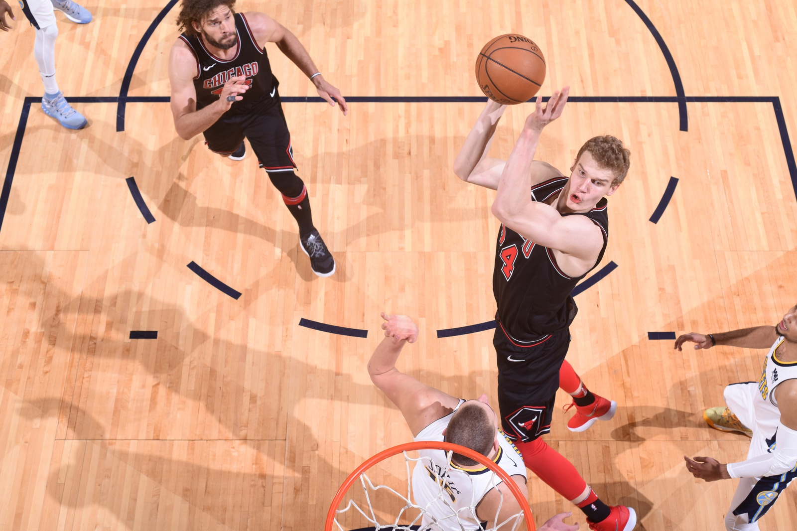 Lauri Markkanen #24 of the Chicago Bulls goes to the basket against the Denver Nuggets on November 30, 2017 at the Pepsi Center in Denver, Colorado.