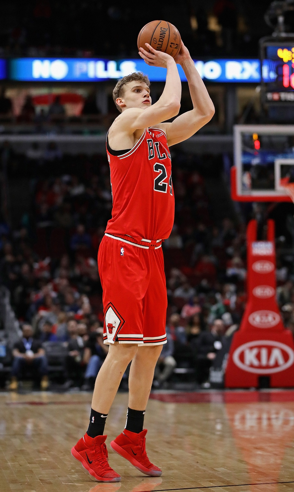 Lauri Markkanen #24 of the Chicago Bulls shoots three point shot against the Atlanta Hawks at the United Center on January 23, 2019 in Chicago, Illinois. The Hawks defeated the Bulls 121-101.