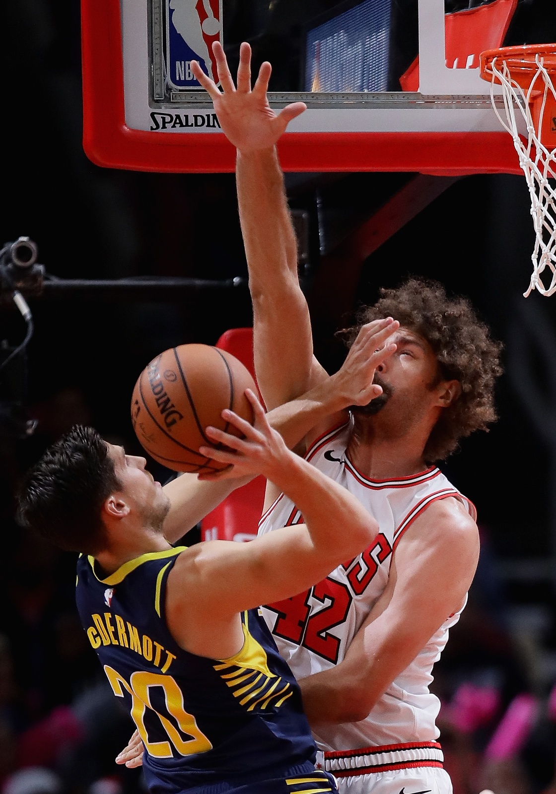 Doug McDermott #20 of the Indiana Pacers is called for an offensive foul against Robin Lopez #42 of the Chicago Bulls during a preseason game at the United Center on October 10, 2018 in Chicago, Illinois.