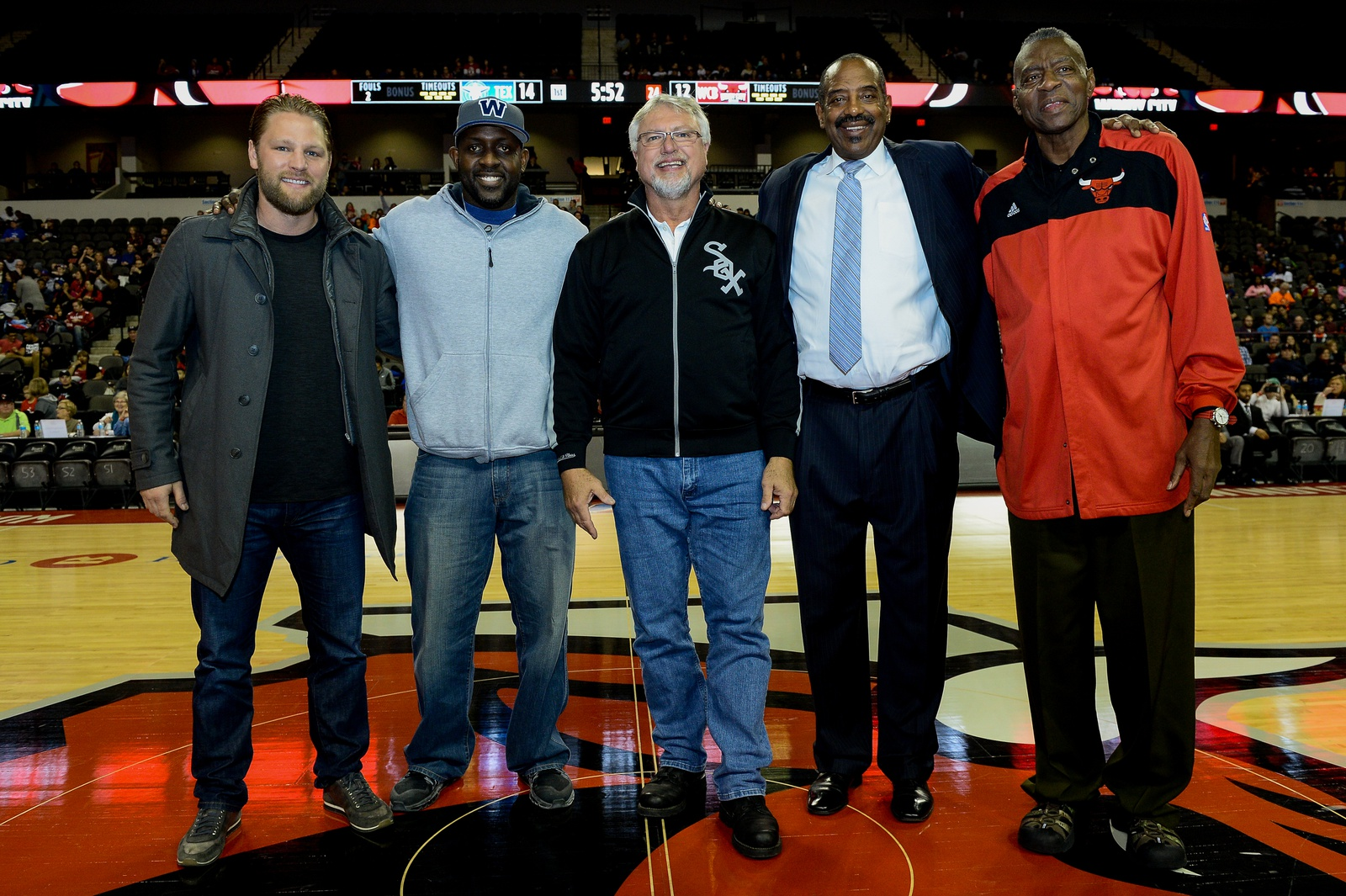 (L-R) Ben Eager (Chicago Blackhawks), Desmond Clark (Chicago Bears), Ron Kittle (Chicago Whitesox), Mickey Johnson and Bob Love of the (Chicago Bulls) posed for a photo center court during the game between the Windy City Bulls and the Texas Legends on November 19, 2016 at The Sears Centre in Hoffman Estates, Illinois.
