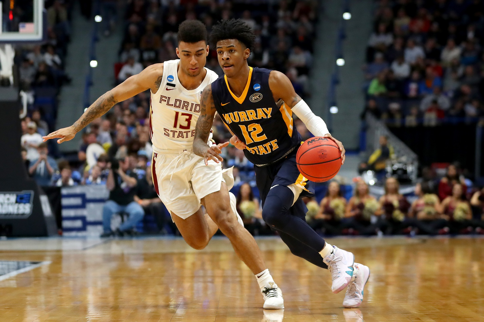 Ja Morant #12 of the Murray State Racers is defended by Anthony Polite #13 of the Florida State Seminoles in the second half during the second round of the 2019 NCAA Men's Basketball Tournament at XL Center on March 23, 2019 in Hartford, Connecticut