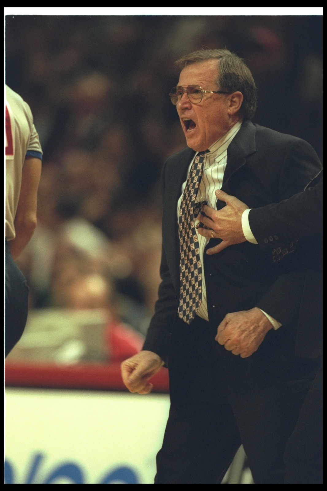 19 Dec 1995: Dallas Mavericks head coach Dick Motta yells during a game against the Chicago Bulls at the United Center in Chicago, Illinois. The Bulls won the game, 114-101.