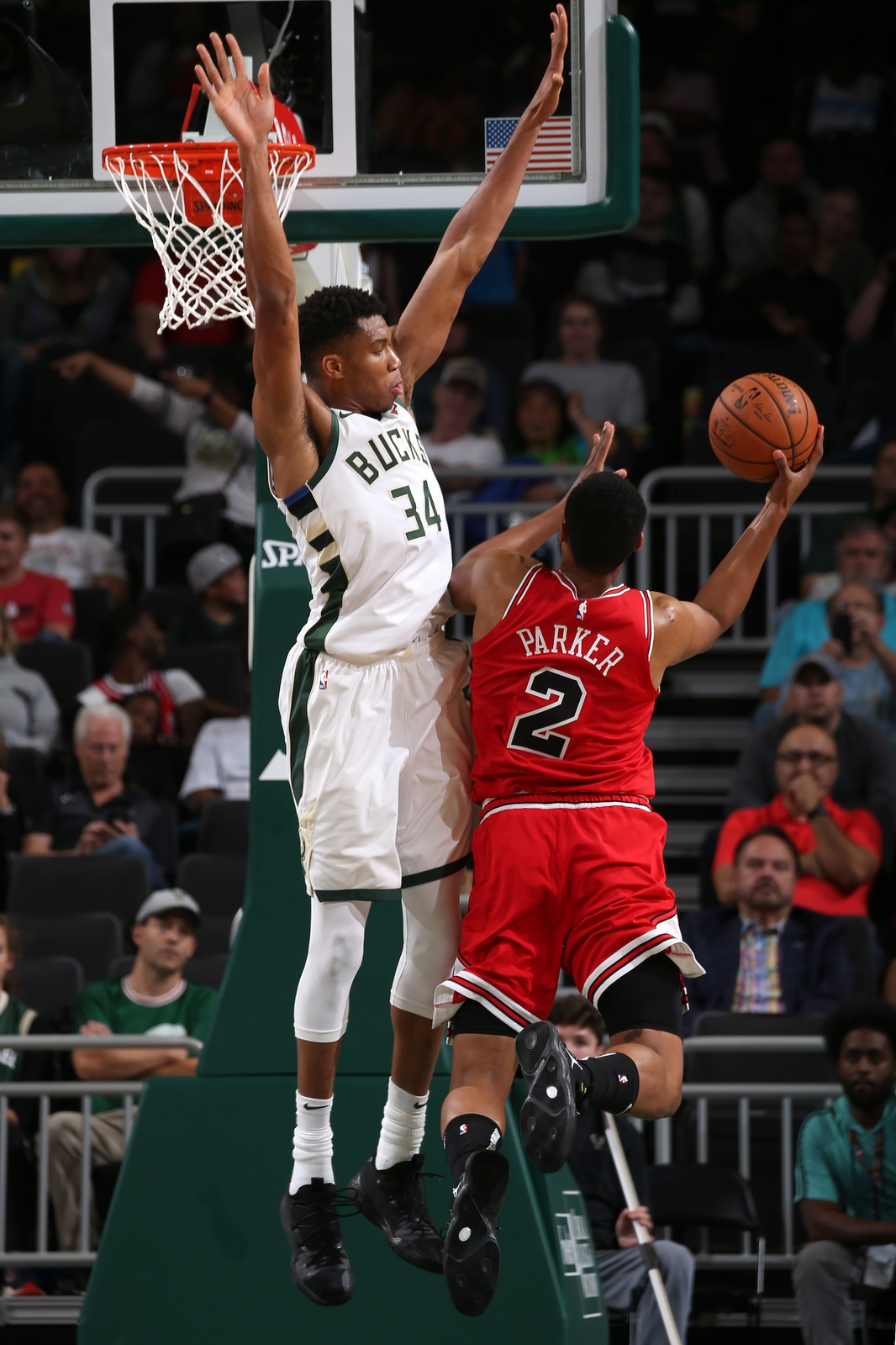 Jabari Parker #2 of the Chicago Bulls attempts to shoot the ball against Giannis Antetokounmpo #34 of the Milwaukee Bucks during a pre-season game on October 3, 2018 at Fiserv Forum, in Milwaukee, Wisconsin.