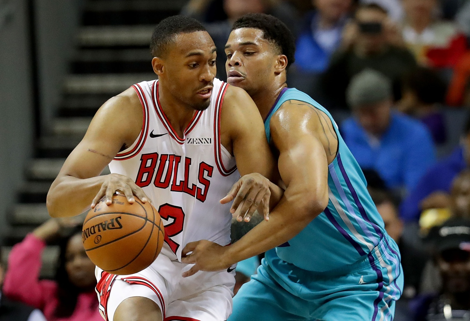 Miles Bridges #0 of the Charlotte Hornets tries to stop Jabari Parker #2 of the Chicago Bulls during their game at Spectrum Center on October 26, 2018 in Charlotte, North Carolina.