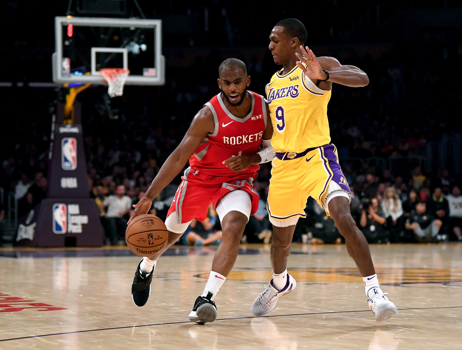 Chris Paul #3 of the Houston Rockets drives on Rajon Rondo #9 of the Los Angeles Lakers during the second quarter at Staples Center on October 20, 2018 in Los Angeles, California.