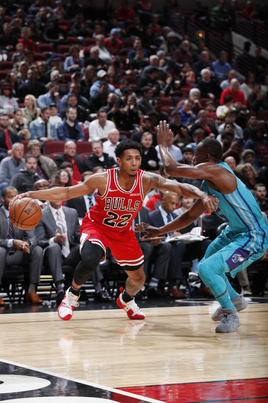 Cameron Payne #22 of the Chicago Bulls handles the ball against the Charlotte Hornets on October 24, 2018 at United Center in Chicago, Illinois.