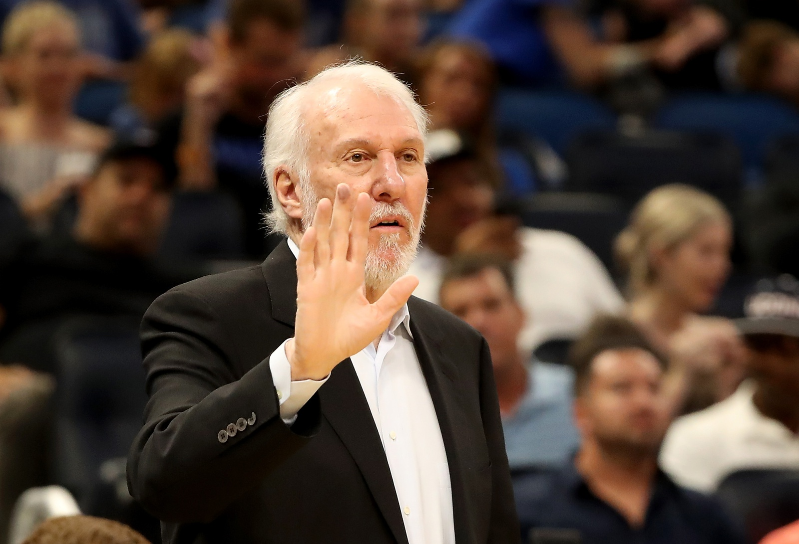Head coach Gregg Popovich of the San Antonio Spurs calls out a play during a pre-season game against the Orlando Magic at Amway Center on October 12, 2018 in Orlando, Florida.