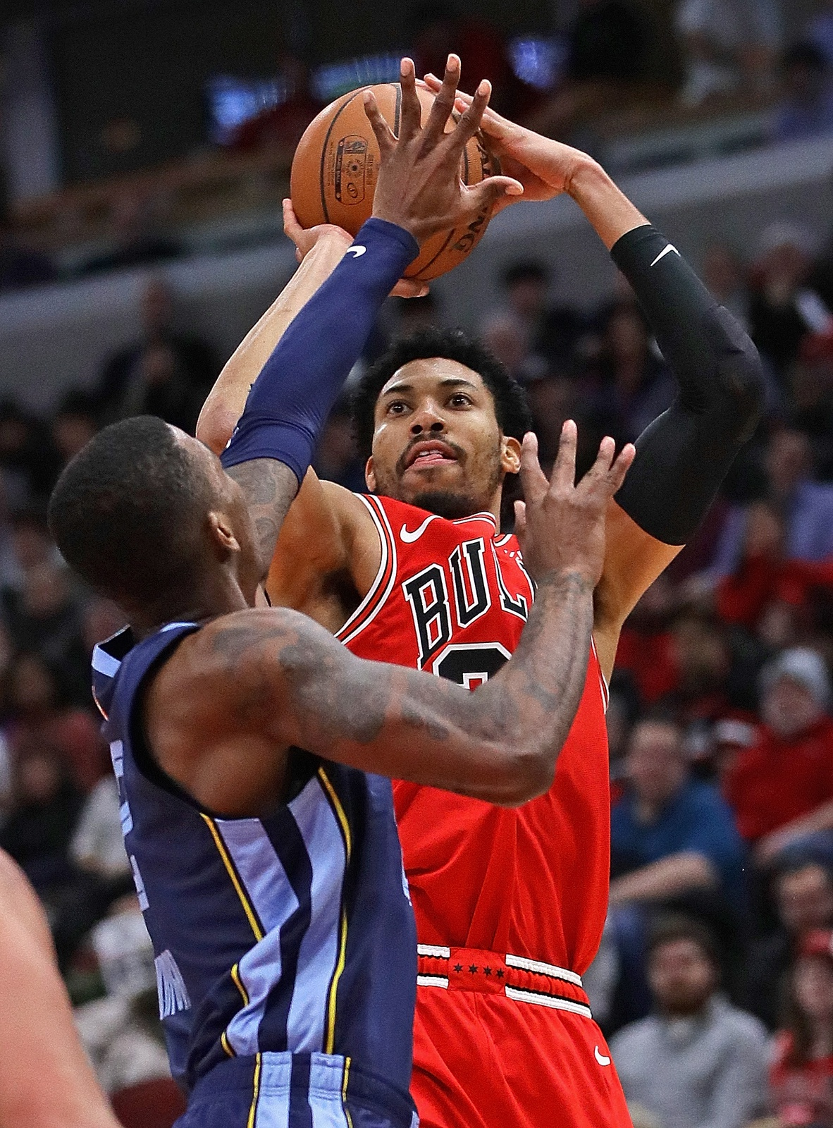 Otto Porter Jr. #22 of the Chicago Bulls puts up a shot over Delon Wright #2 of the Memphis Grizzlies on his way to a game-high 37 points at the United Center on February 13, 2019 in Chicago, Illinois. The Bulls defeated the Grizzlies 122-110