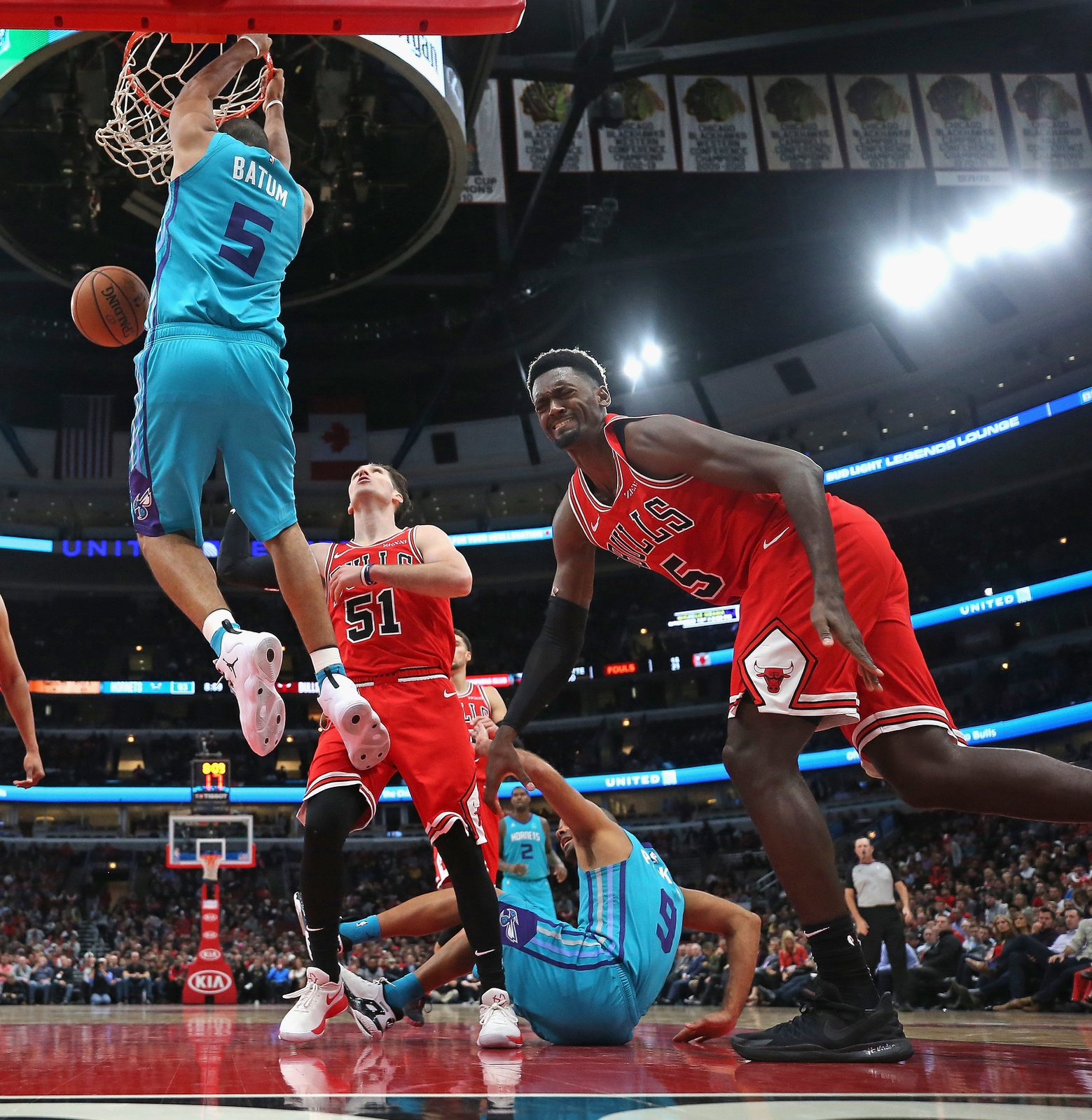 Bobby Portis #5 of the Chicago Bulls winces in pain after trying to stop Nicolas Batum #5 of the Charlotte Hornets from dunking at the United Center on October 24, 2018 in Chicago, Illinois. The Bulls defeated the Hornets 112-110.