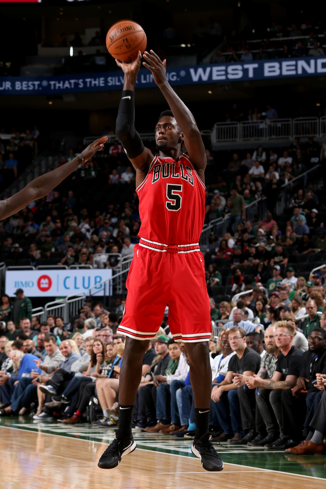 Bobby Portis #5 of the Chicago Bulls shoots the ball against the Milwaukee Bucks during a pre-season game on October 3, 2018 at Fiserv Forum, in Milwaukee, Wisconsin.
