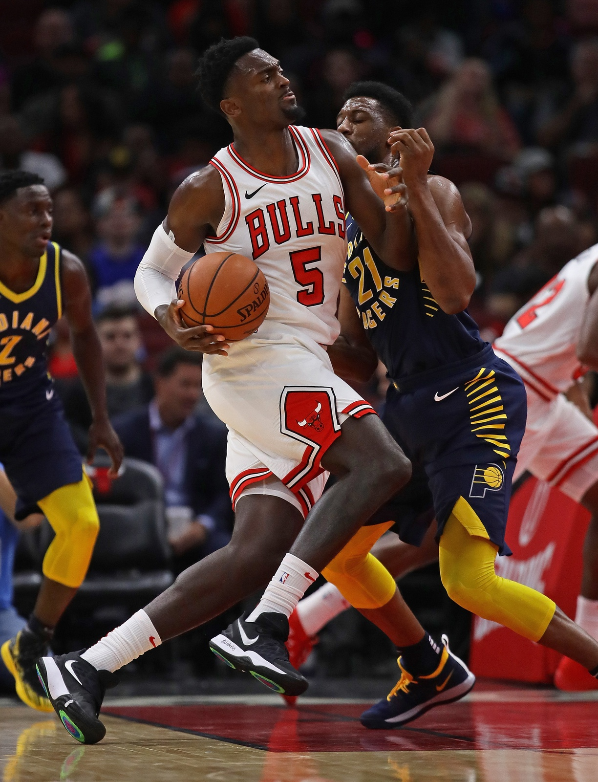 Bobby Portis #5 of the Chicago Bulls drives against Thaddeus Young #21 of the Indiana Pacers during a preseason game at the United Center on October 10, 2018 in Chicago, Illinois.