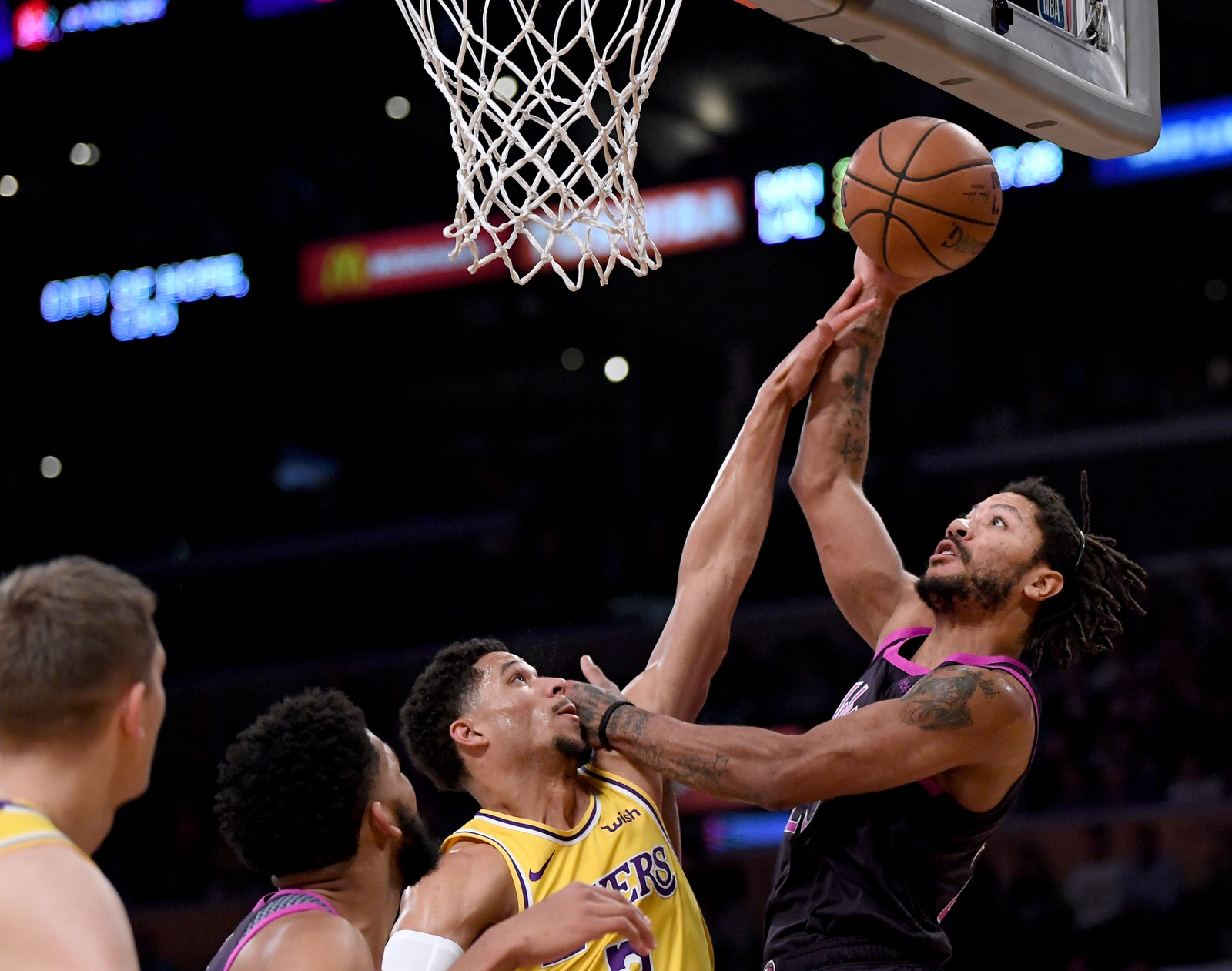 Derrick Rose #25 of the Minnesota Timberwolves attempts a shot over Josh Hart #3 of the Los Angeles Lakers during the first half at Staples Center on January 24, 2019 in Los Angeles, California.