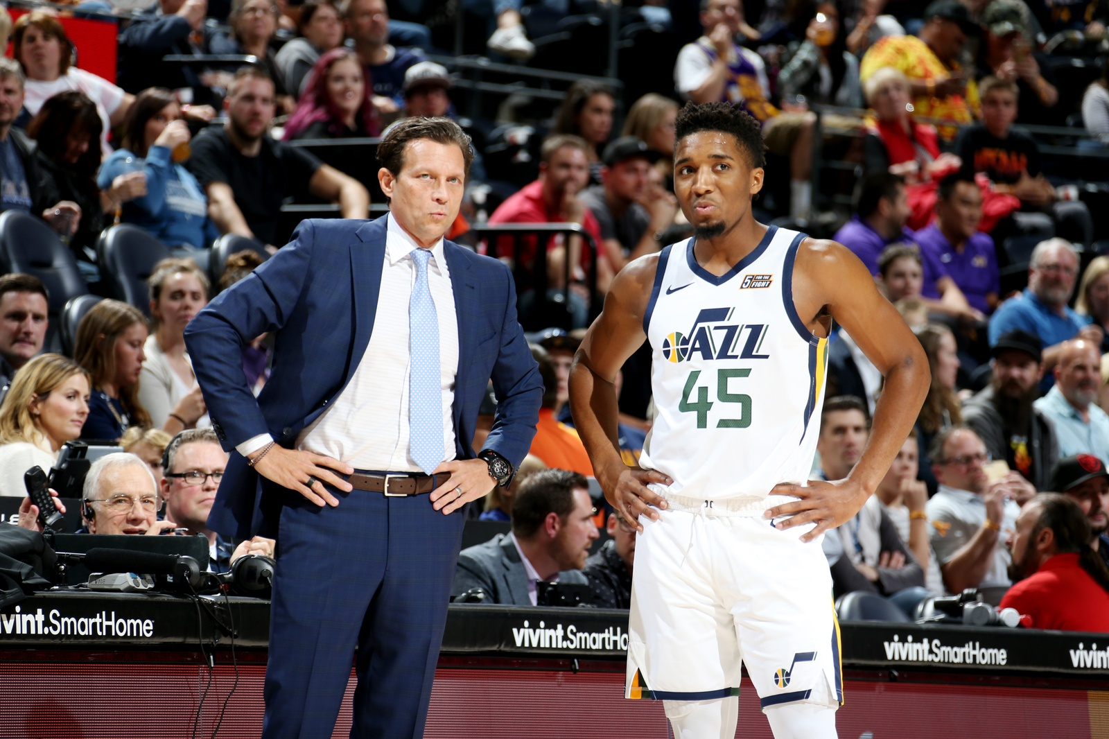 Head Coach Quin Snyder and Donovan Mitchell #45 of the Utah Jazz look on during a pre-season game against Adelaide 36ers on October 5, 2018 at vivint.SmartHome Arena in Salt Lake City, Utah.
