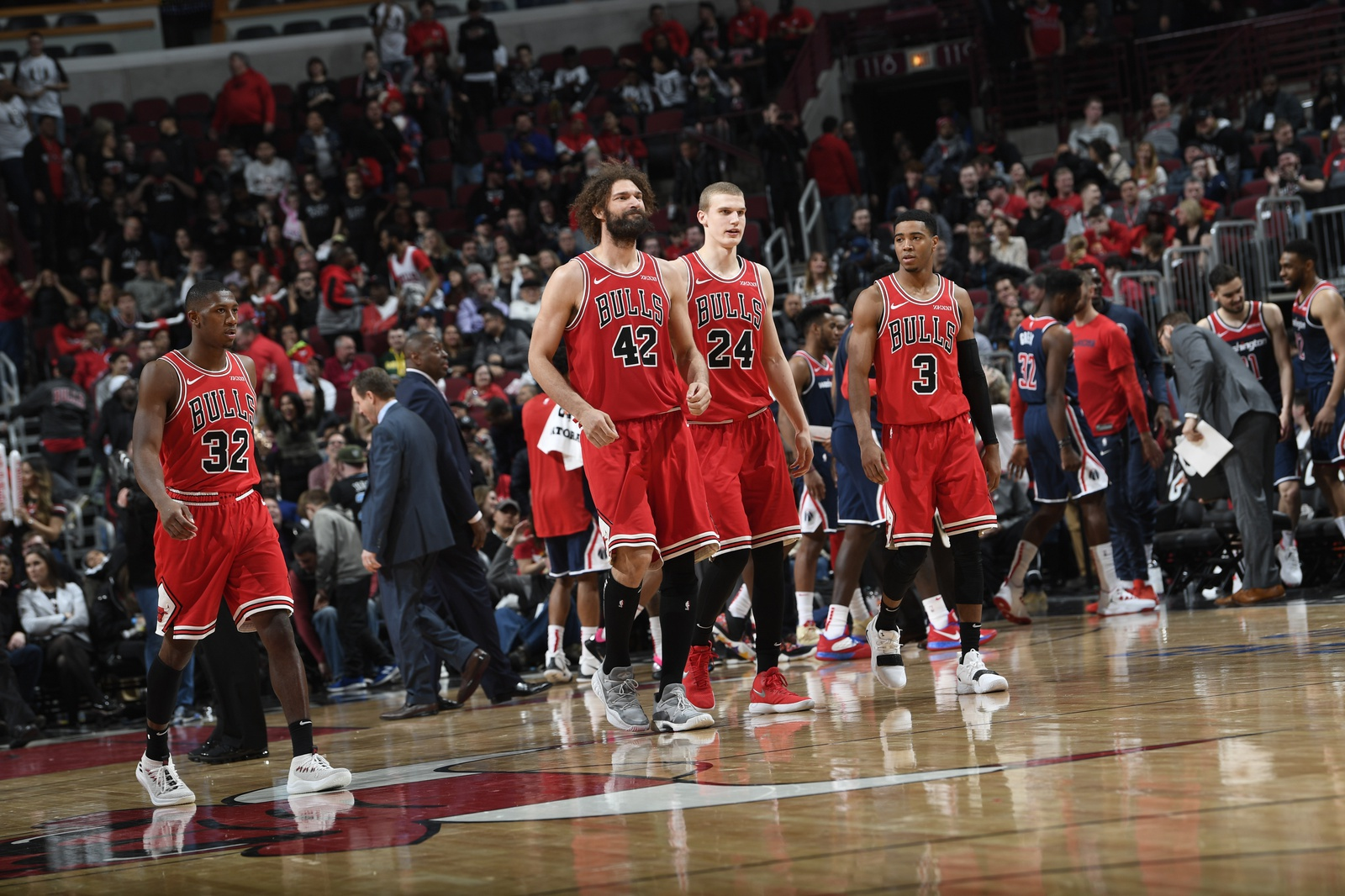 A team shot of the Chicago Bulls walking toward the bench