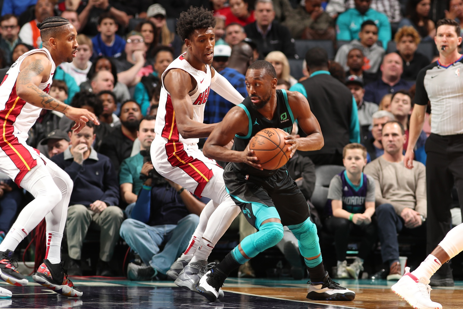 Kemba Walker #15 of the Charlotte Hornets handles the ball against the Miami Heat on March 6, 2019 at Spectrum Center in Charlotte, North Carolina