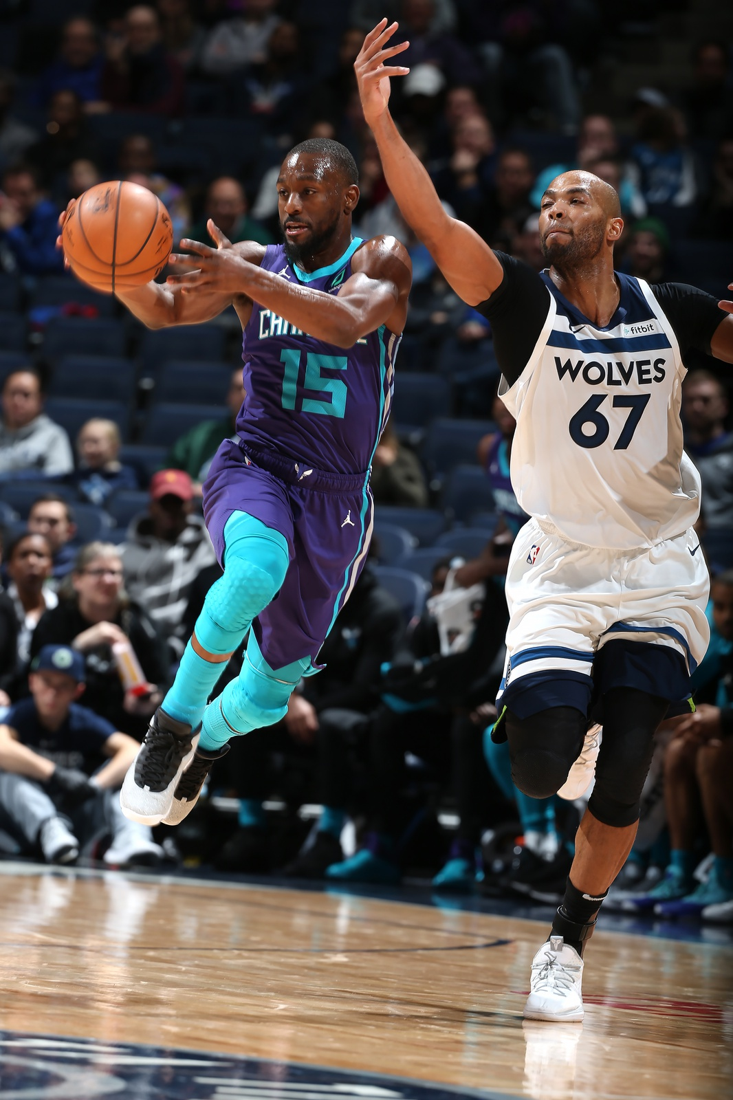 Kemba Walker #15 of the Charlotte Hornets grabs the ball against the Minnesota Timberwolves on December 5, 2018 at Target Center in Minneapolis, Minnesota.