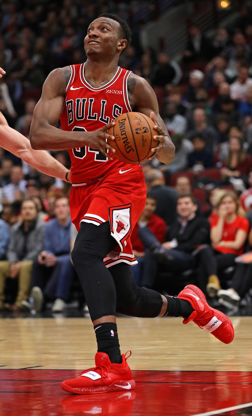 Wendell Carter Jr. #34 of the Chicago Bulls drives through the lane against the Denver Nuggets at the United Center on October 31, 2018 in Chicago, Illinois. The Nuggets defeated the Bulls 108-107 in overtime.