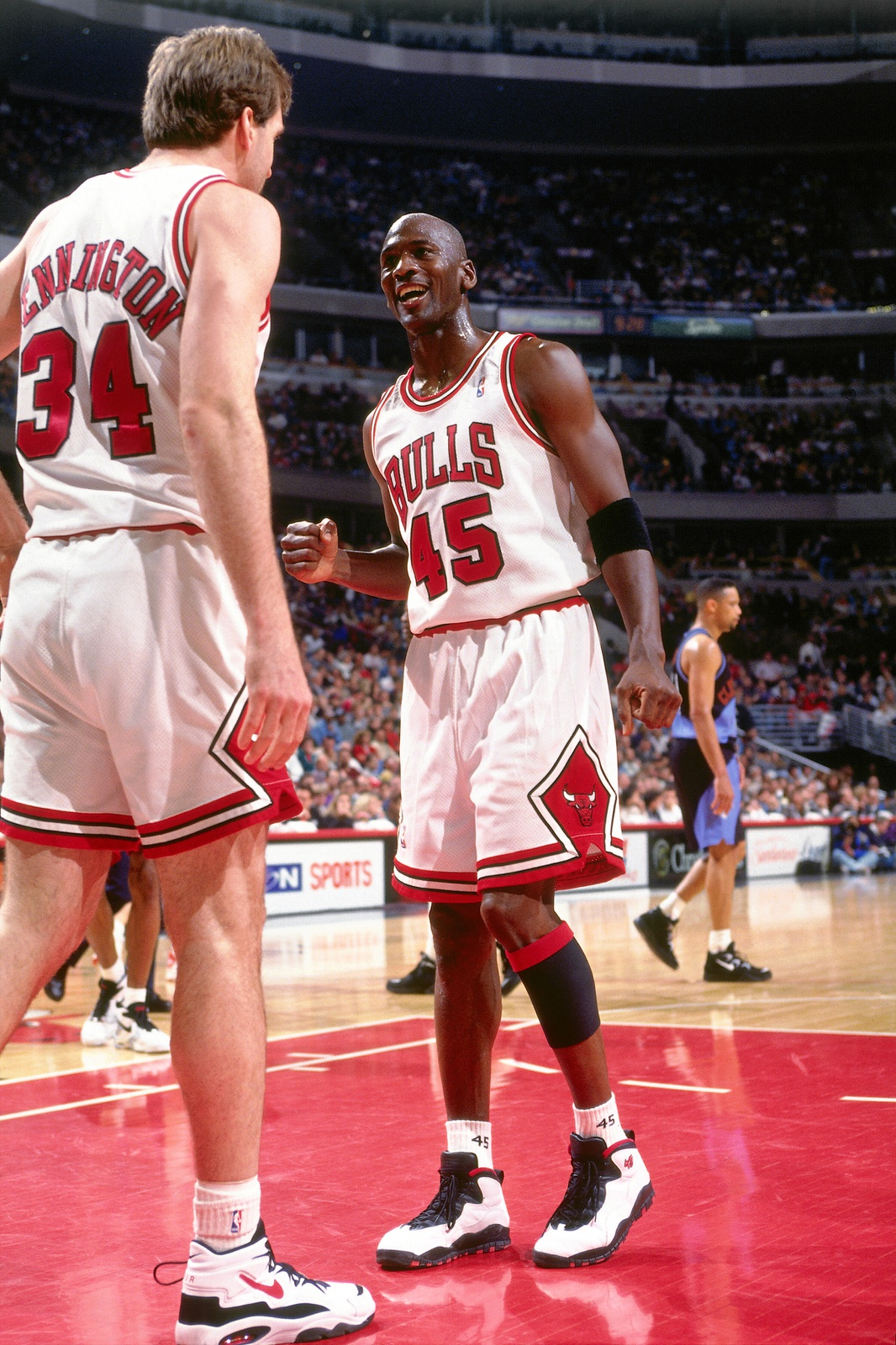 Michael Jordan #45 and Bill Wennington #34 of the Chicago Bulls talk during a game played on April 7, 1995 at the United Center in Chicago, Illinois.