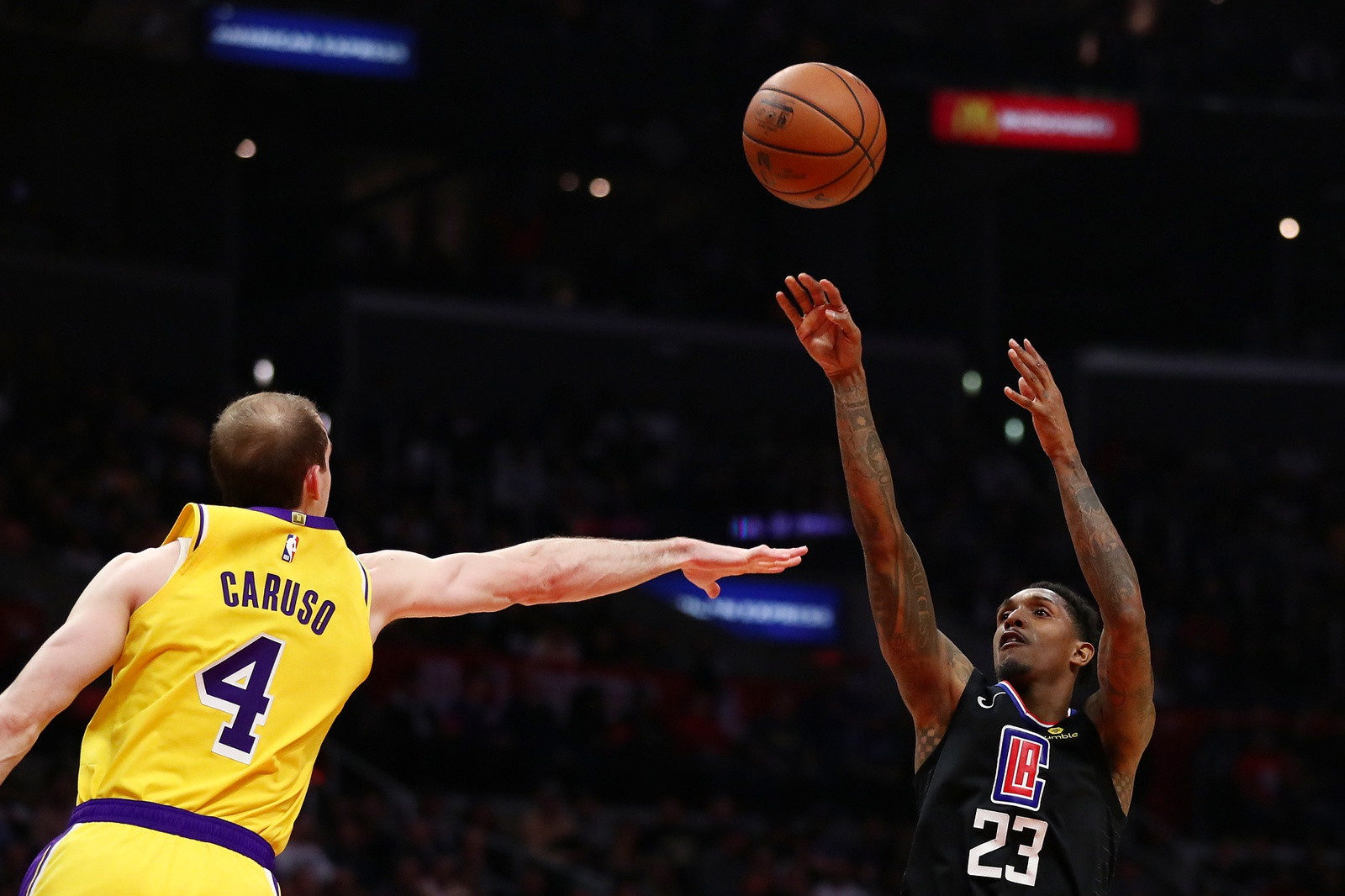 Lou Williams #23 of the Los Angeles Clippers shoots the ball against Alex Caruso #4 of the Los Angeles Lakers during the second half at Staples Center on April 05, 2019 in Los Angeles, California.
