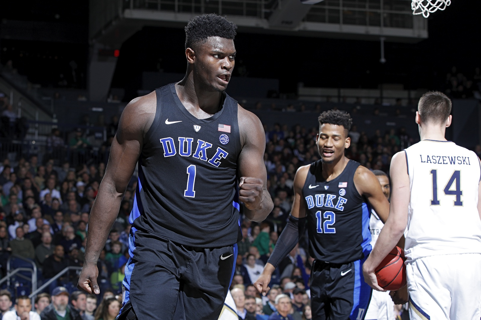 Zion Williamson #1 of the Duke Blue Devils reacts after scoring a basket and drawing a foul against the Notre Dame Fighting Irish in the second half of the game at Purcell Pavilion on January 28, 2019 in South Bend, Indiana.