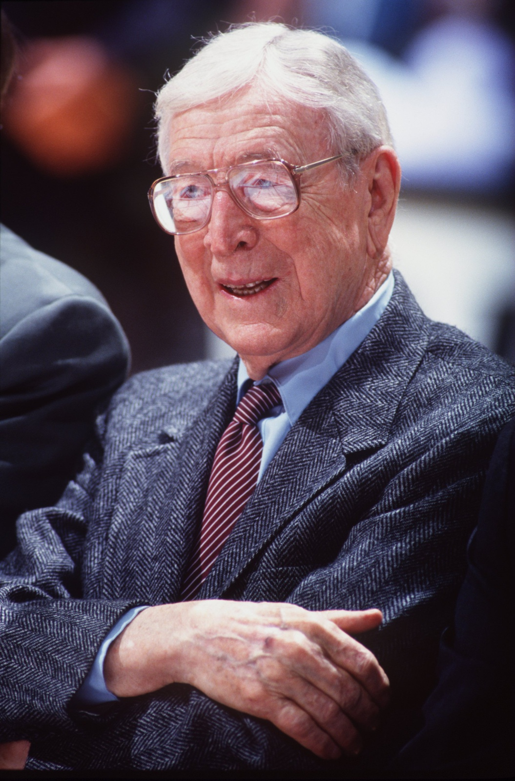 3 DEC 1994: EX-UCLA HEAD COACH JOHN WOODEN WATCHES THE ACTION DURING THE INAGURAL WOODEN CLASSIC TOURNAMENT AT THE POND IN ANAHEIM, CALIFORNIA.