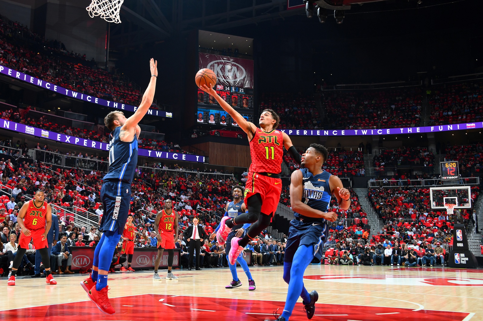 Luka Doncic #77 of the Dallas Mavericks contests the shot by Trae Young #11 of the Atlanta Hawks on October 24, 2018 at State Farm Arena in Atlanta, Georgia